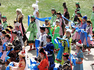Mongolians, now very Western in dress, retain a sense of their heritage by celebrating national holidays in native costumes.