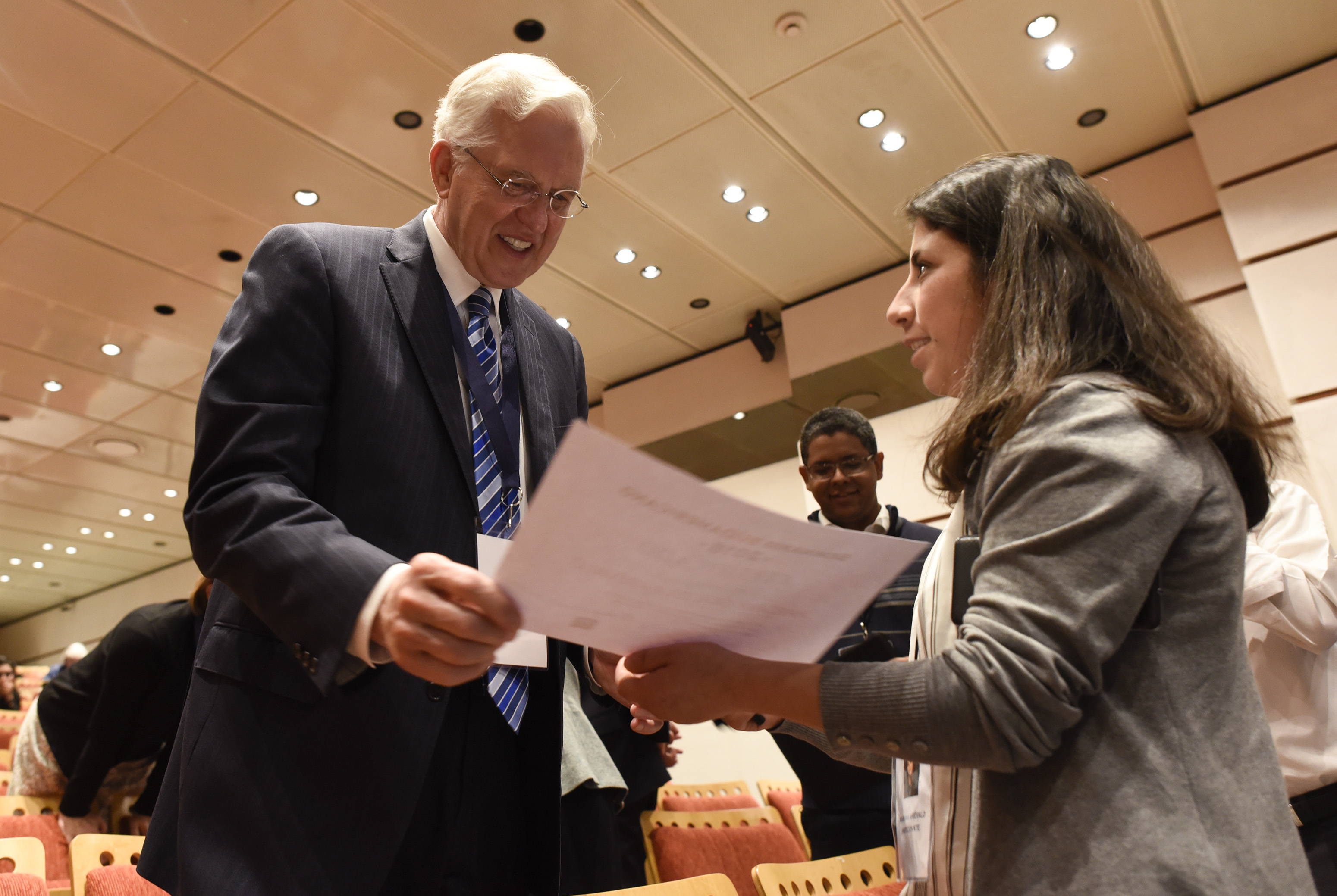 Elder D. Todd Christofferson member of Twelve Apostles of The Church of Jesus Christ of Latter-day Saints speaks with an attendee of the G20 Interfaith Forum in Buenos Aires, Argentina, during a break on Wednesday, Sept. 26, 2018.
