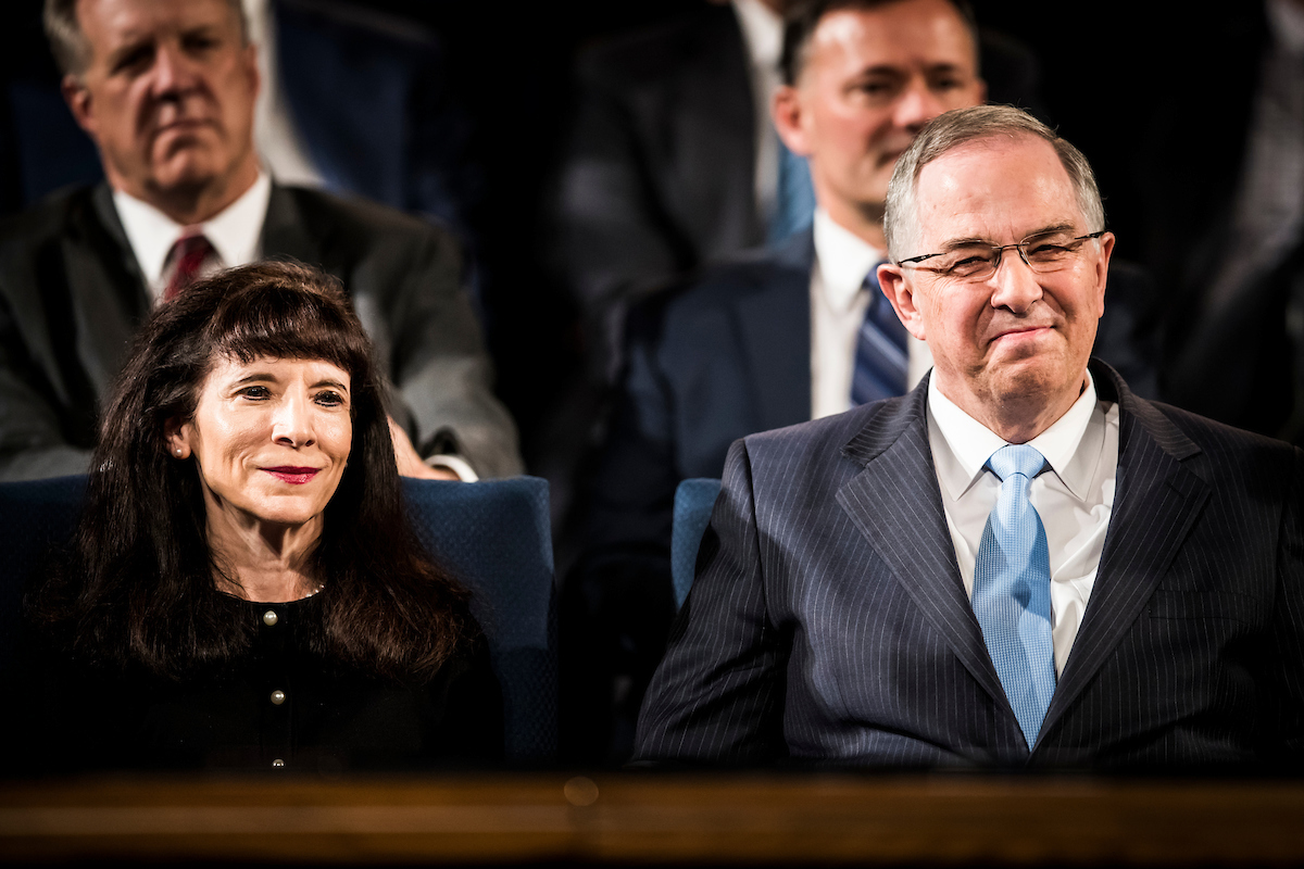 Elder Neil L. Andersen of the Quorum of the Twelve Apostles and his wife, Sister Kathy Andersen, sit on the stand during a campus devotional on April 10.