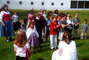 Hyde Park Ward Primary children enjoy activities conducted by their leaders on the London England Temple grounds while parents do temple work.
