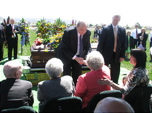 At gravesite, President Thomas S. Monson places rose on casket of his beloved associate, Elder Jack H. Goaslind, who served for 20 years in the Seventy, including two terms in the Presidency of the Seventy, and as Young Men general president.