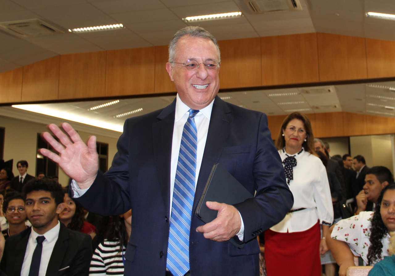 Elder Ulisses Soares, joined by his wife, Sister Rossana Soares, greets attendees as they arrive at a youth devotional Saturday, June 1, 2019, the evening before the dedication of the adjacent Fortaleza Brazil Temple.