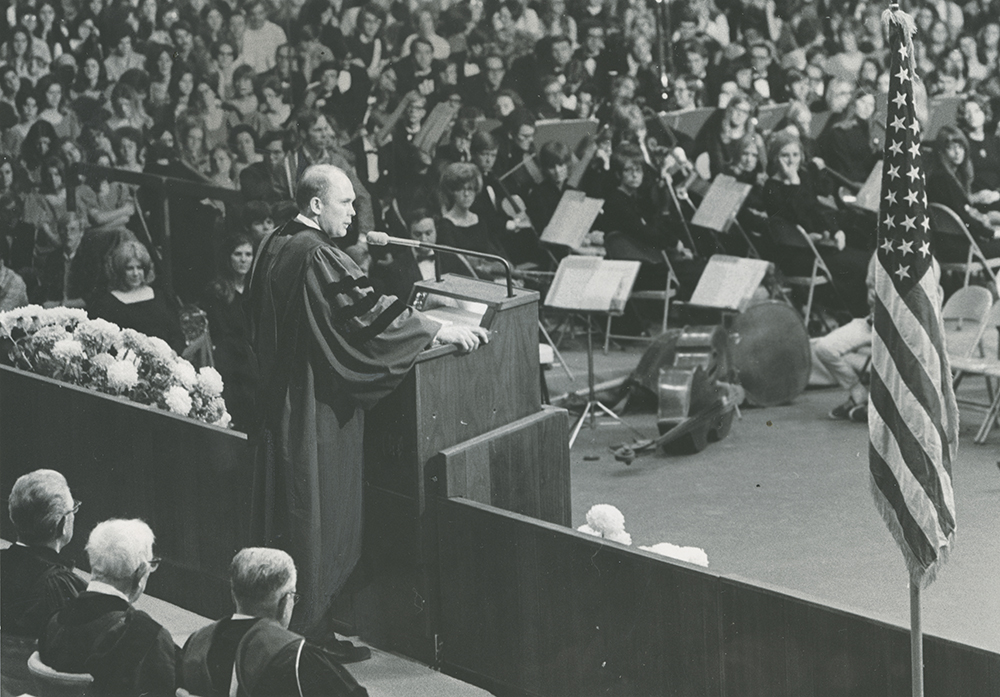 Dallin Oaks speaks to a capacity crowd at his inauguration as president of Brigham Young University in 1971.