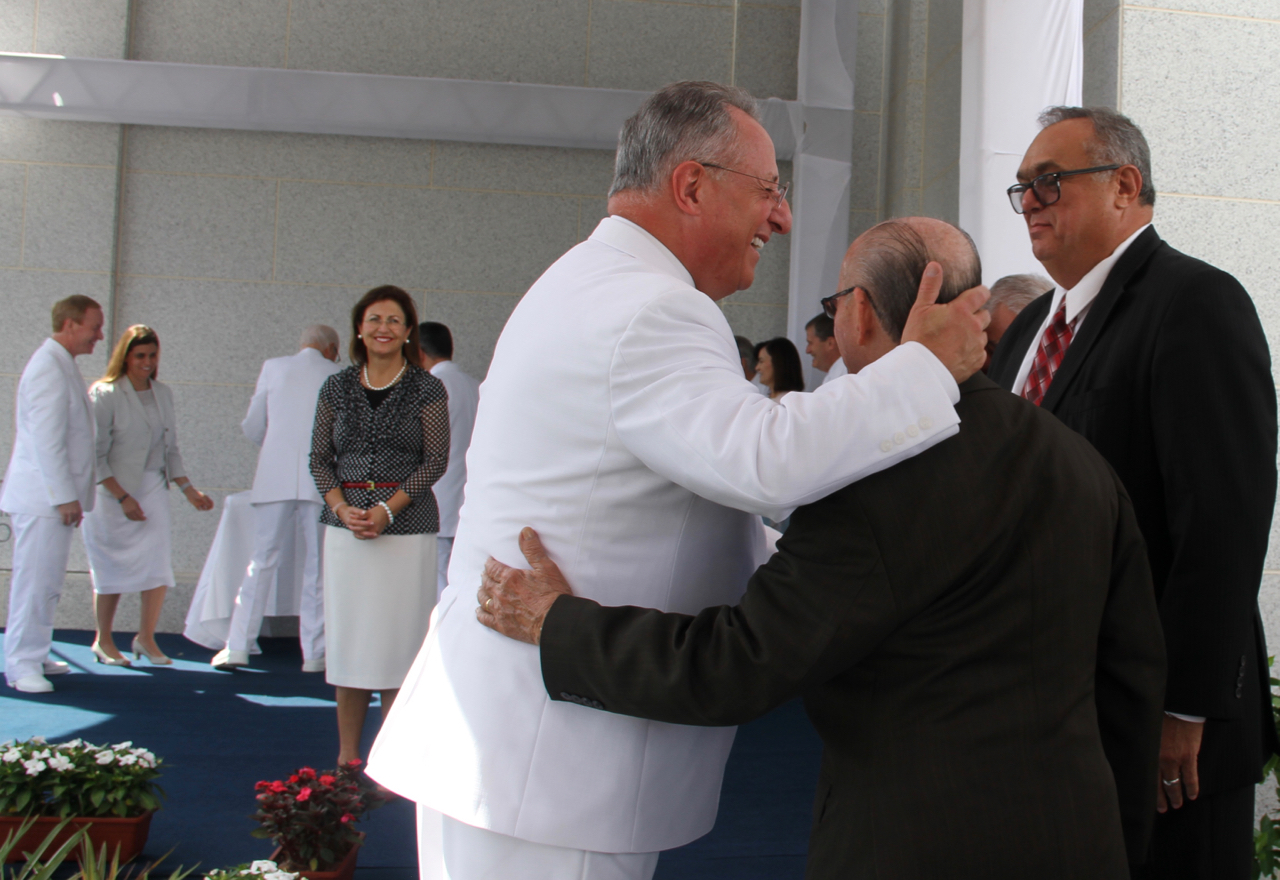 Elder Ulisses Soares of the Quorum of the Twelve Apostles cups the head of Lino Cintra at the cornerstone ceremony of the Fortaleza Brazil Temple on June 2, 2019. Elder Soares invited Cintra and several other early Fortaleza saints to participate at the cornerstone.