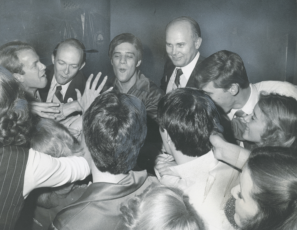 "BYU Pres. Dallin H. Oaks, top right, joins Young Ambassadors for ""let's go"" cheer before taping in Kiev, Soviet Union."