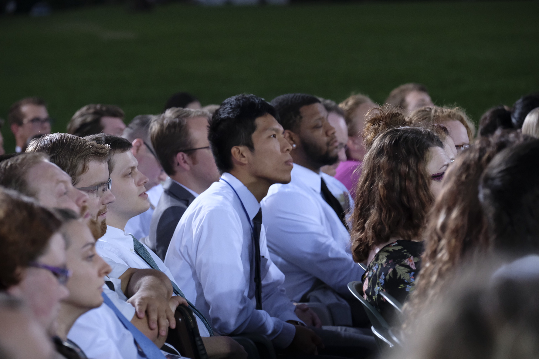 """Young adults listen to Elder Quentin L. Cook of the Quorum of the Twelve Apostles speak during a worldwide """"Face to Face"""" broadcast focusing on the history of the Church. Also participating in the Sept. 9, 2018, event, were Church historians Kate Holbrook and Matt Grow."""