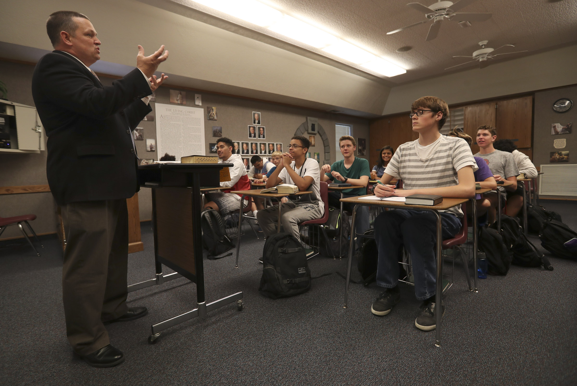 West High seminary principal Trent Smith talks with his students during an LDS seminary class at West High School in Salt Lake City on Monday, Sept. 17, 2018.