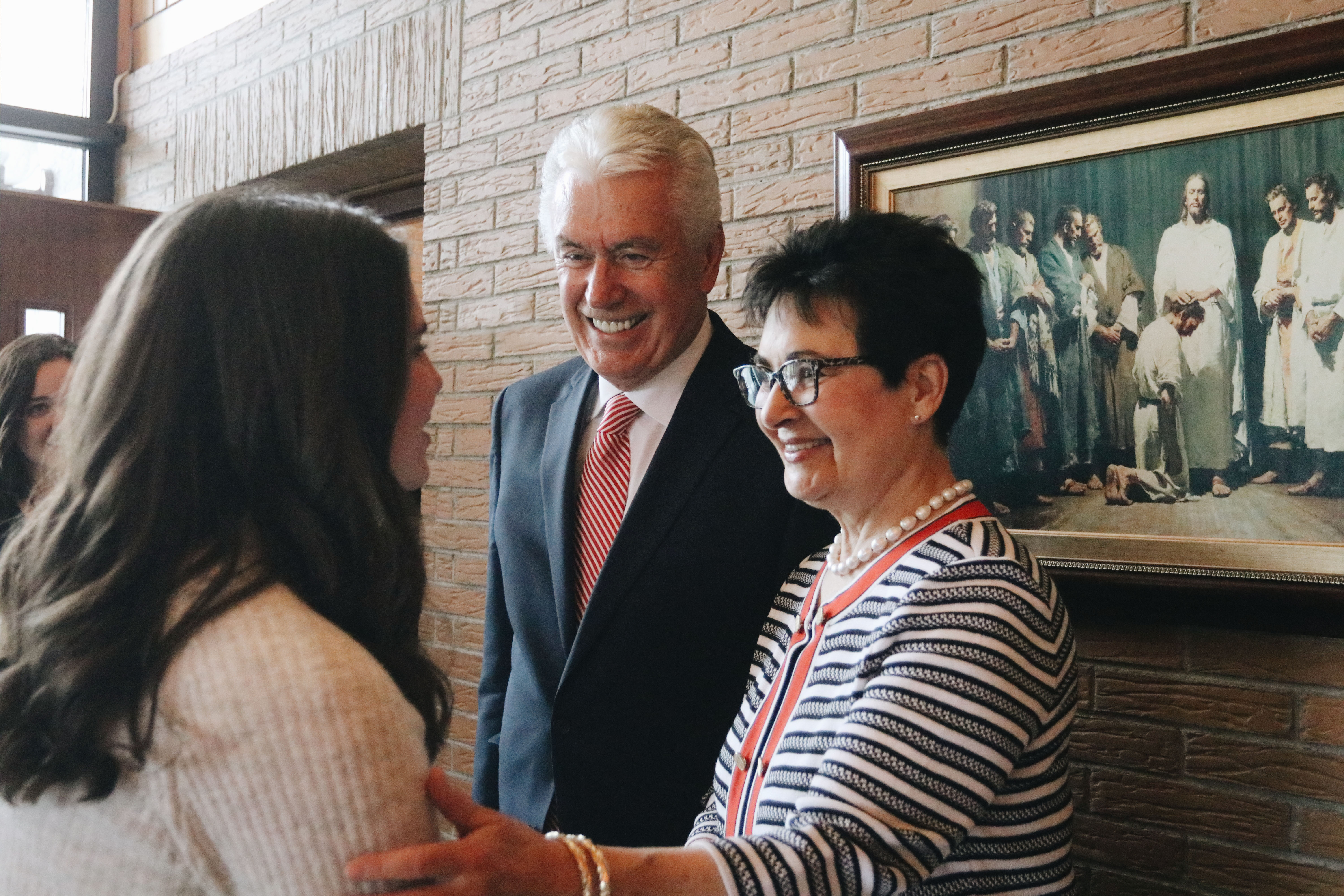 Elder Dieter F. Uchtdorf and Sister Harriet Uchtdorf greet missionaries of the Alpine German-Speaking Mission following a mission meeting in Salzburg, Austria, on April 14, 2019.