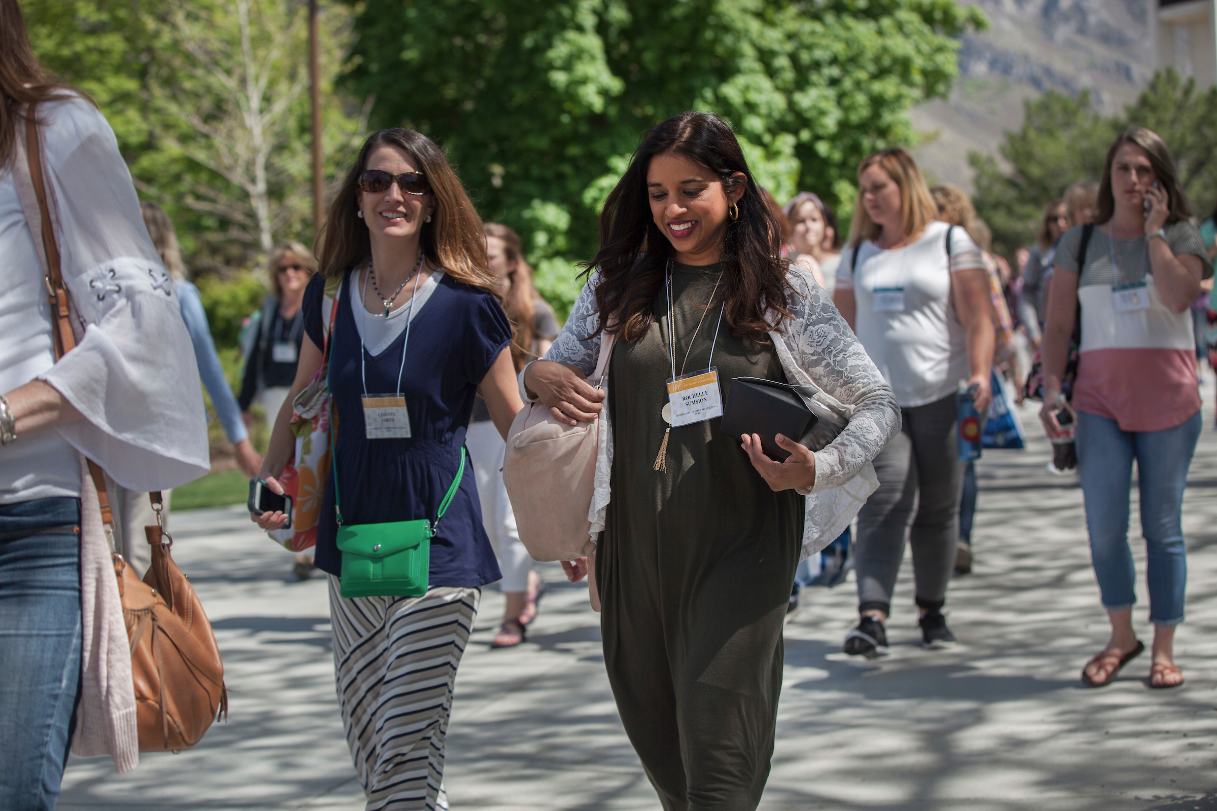 Attendees walk across BYU campus in Provo, Utah, during the annual BYU Women's Conference held May 3-4, 2018.