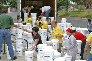 Members of the Fallbrook wards unload cleaning kits for distribution to those affected by fires.