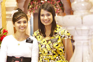 A pair of sister missionaries serve as guides at the Mexico City Temple Visitors Center.