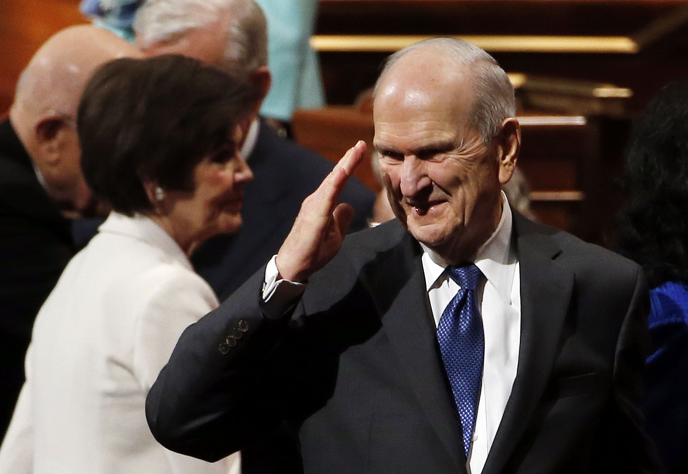 President Russell M. Nelson salutes conferencegoers following the Saturday morning session of the LDS Church's 188th Annual General Conference in Salt Lake City on Saturday, March 31, 2018.