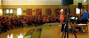Aubree Oliverson participates in a school assembly.