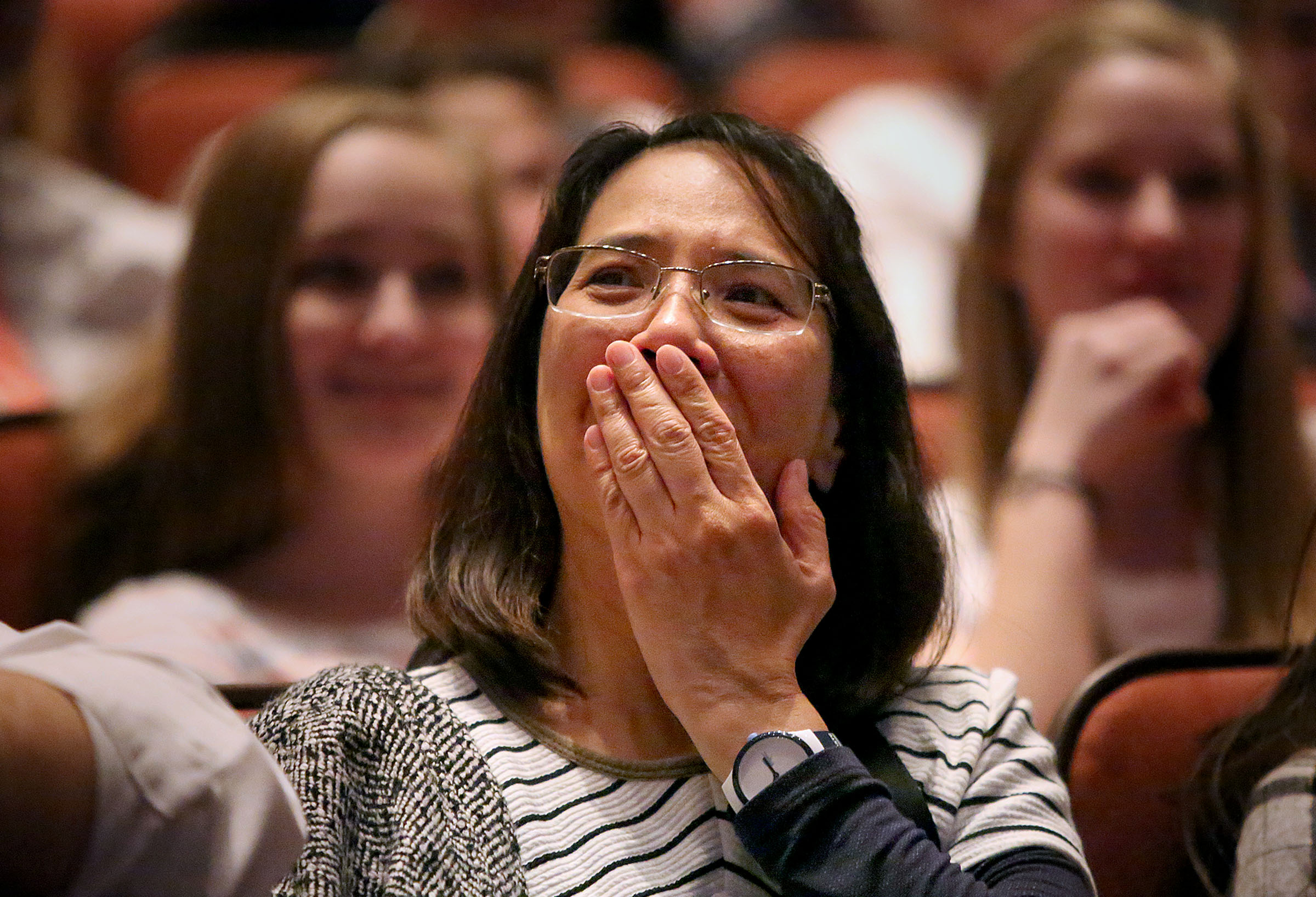 Cheryl Reyes reacts to LDS Church President Russell M. Nelson's announcement that there will be seven new temples around the world, including one in Layton, Utah, during the Sunday afternoon session of the 188th Annual General Conference of The Church of Jesus Christ of Latter-day Saints at the Conference Center in Salt Lake City on Sunday, April 1, 2018.
