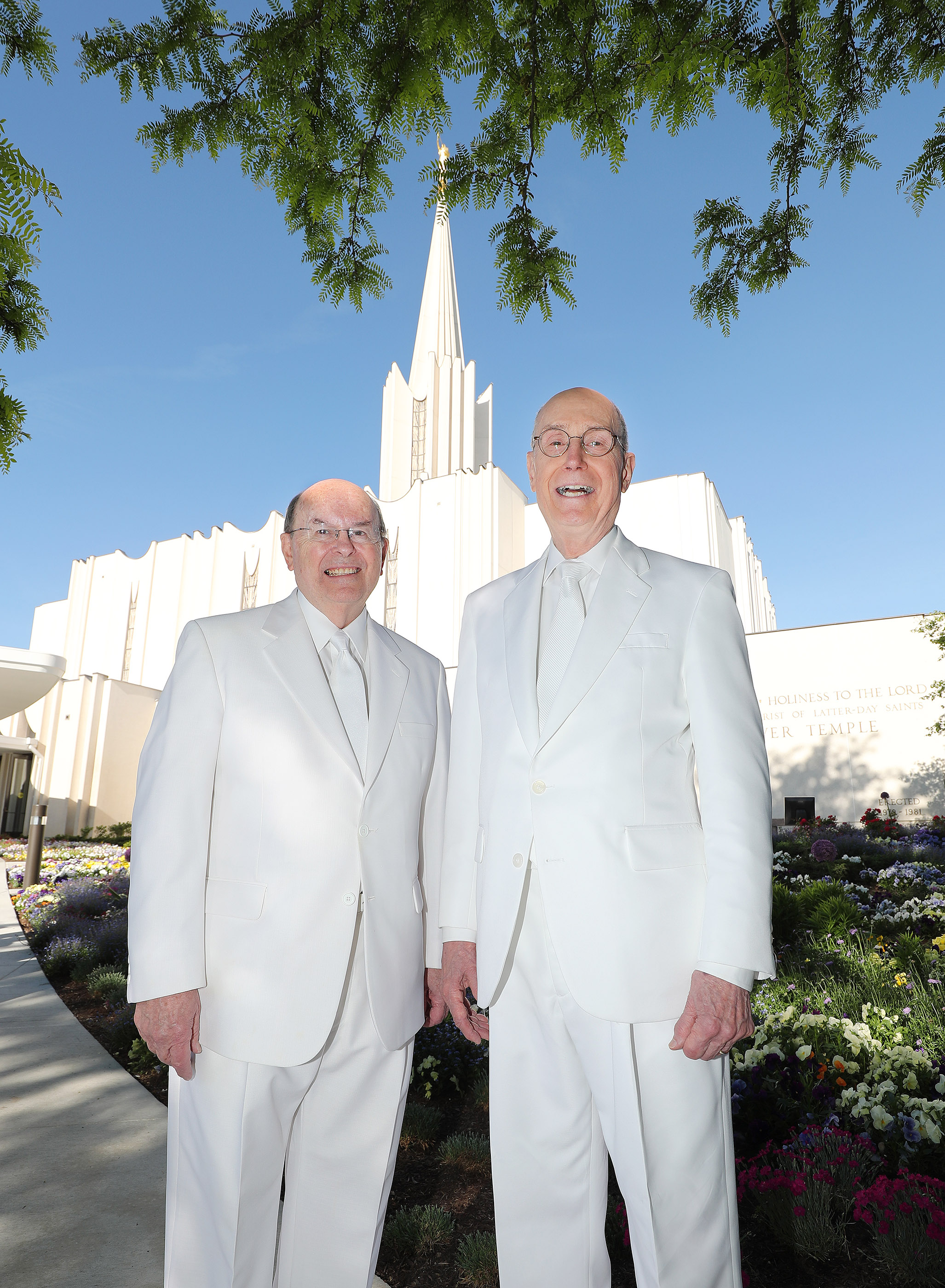 President Henry B. Eyring, second counselor in the First Presidency, right, and Elder Quentin L. Cook of the Quorum of the Twelve Apostles, left, pose outside the Jordan River Utah Temple prior to rededication in South Jordan on Sunday, May 20, 2018.