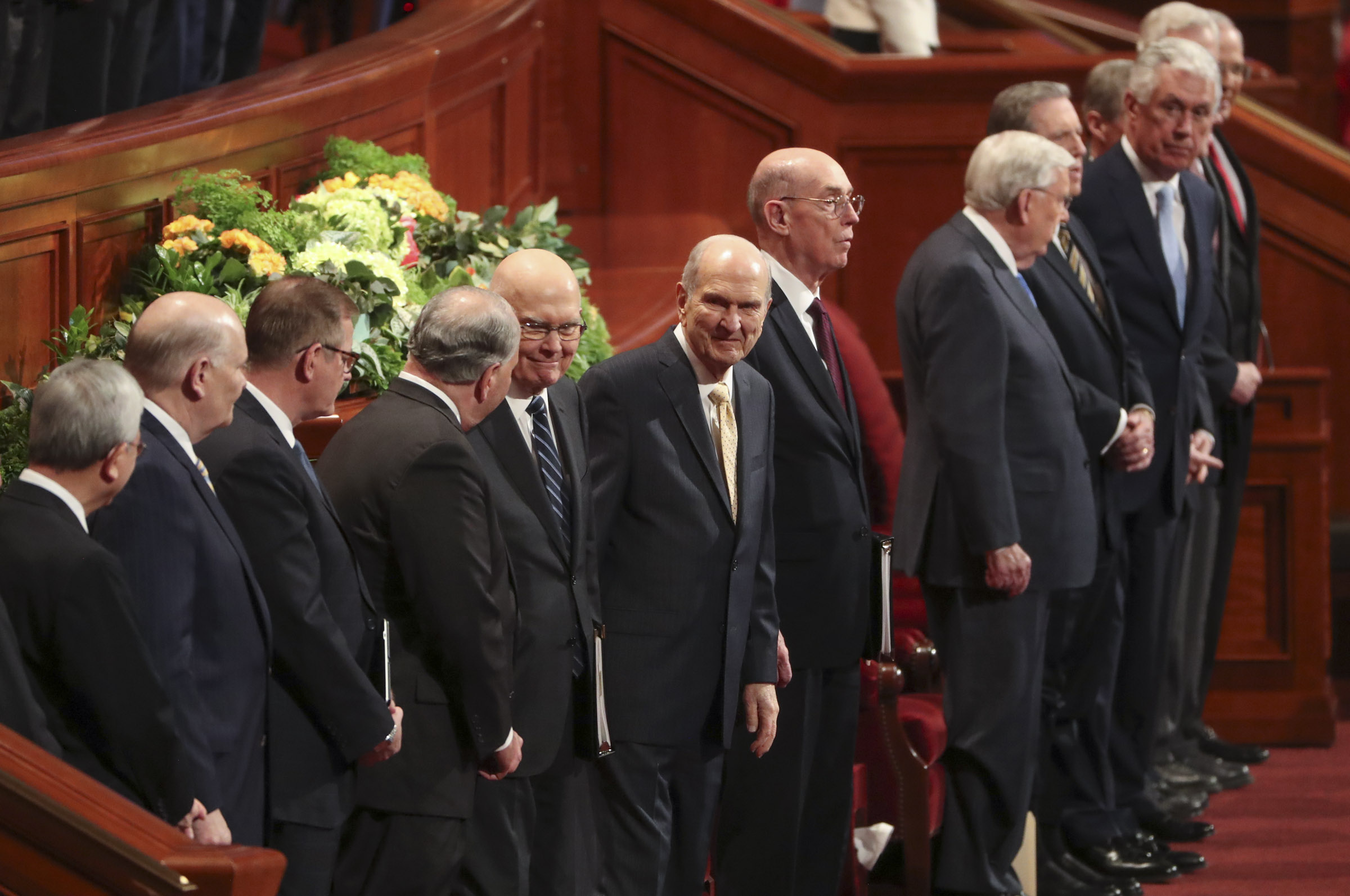 President Russell M. Nelson of The Church of Jesus Christ of Latter-day Saints, center, his counselors and members of the Quorum of the Twelve Apostles stand before the afternoon session of 189th Annual General Conference at the Conference Center in Salt Lake City on Saturday, April 6, 2019.
