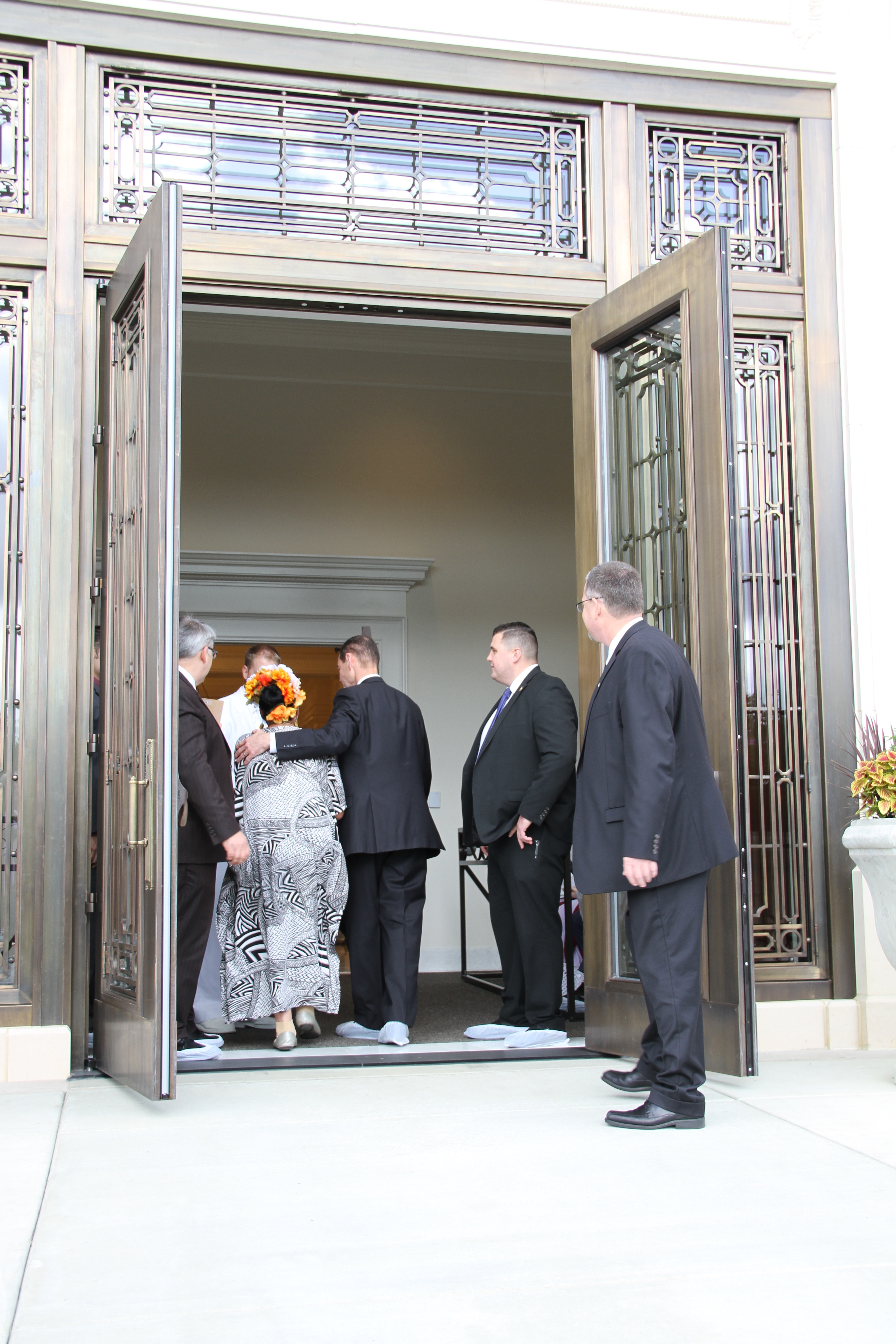 Rosemary Kent, a temple worker in the Memphis Tennessee Temple district enters the temple for the rededication ceremony on May 5, 2019.