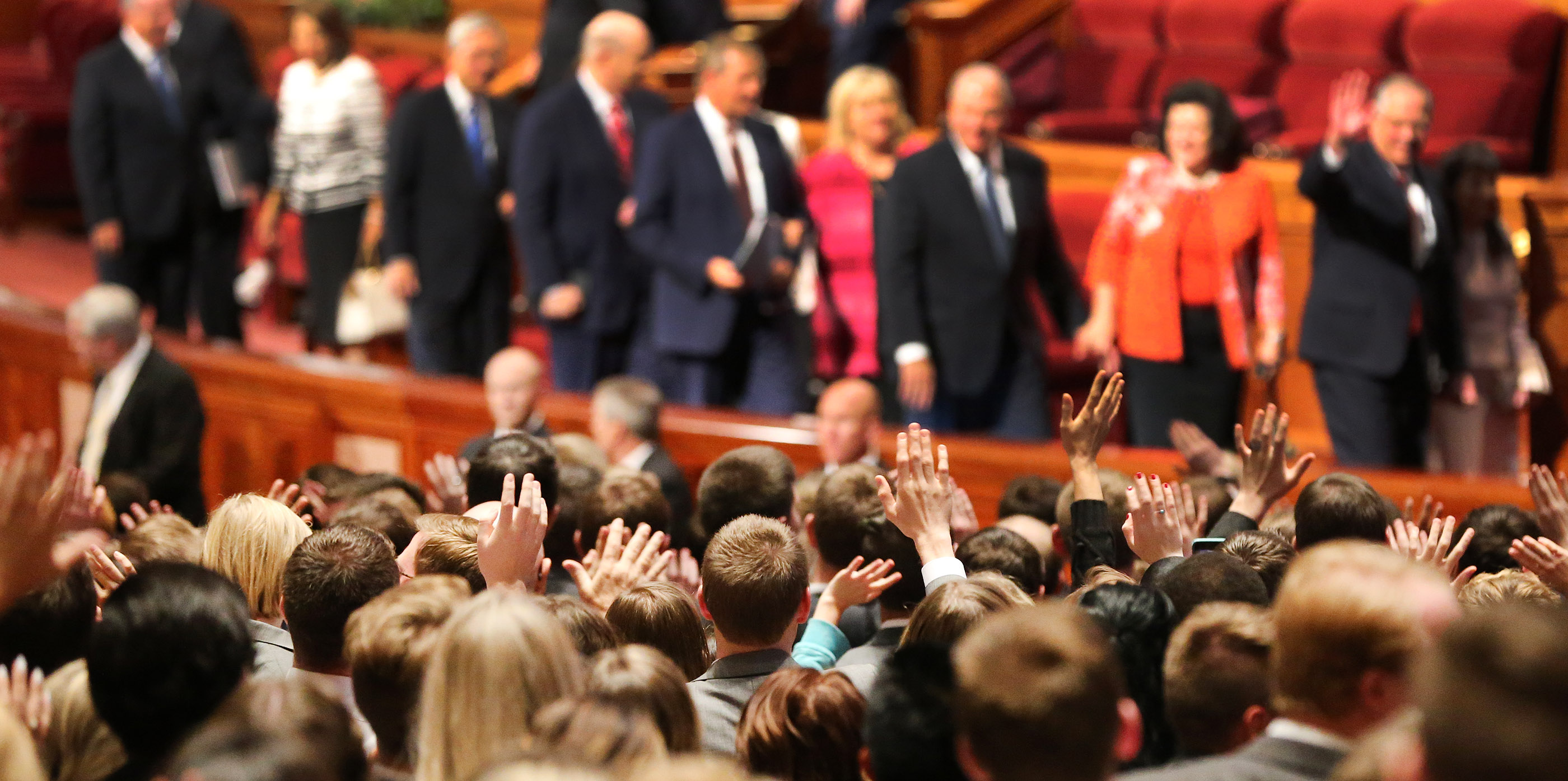 Attendees wave to general authorities after the Sunday afternoon session of the 188th Semiannual General Conference of The Church of Jesus Christ of Latter-day Saints in the Conference Center in downtown Salt Lake City on Sunday, Oct. 7, 2018.