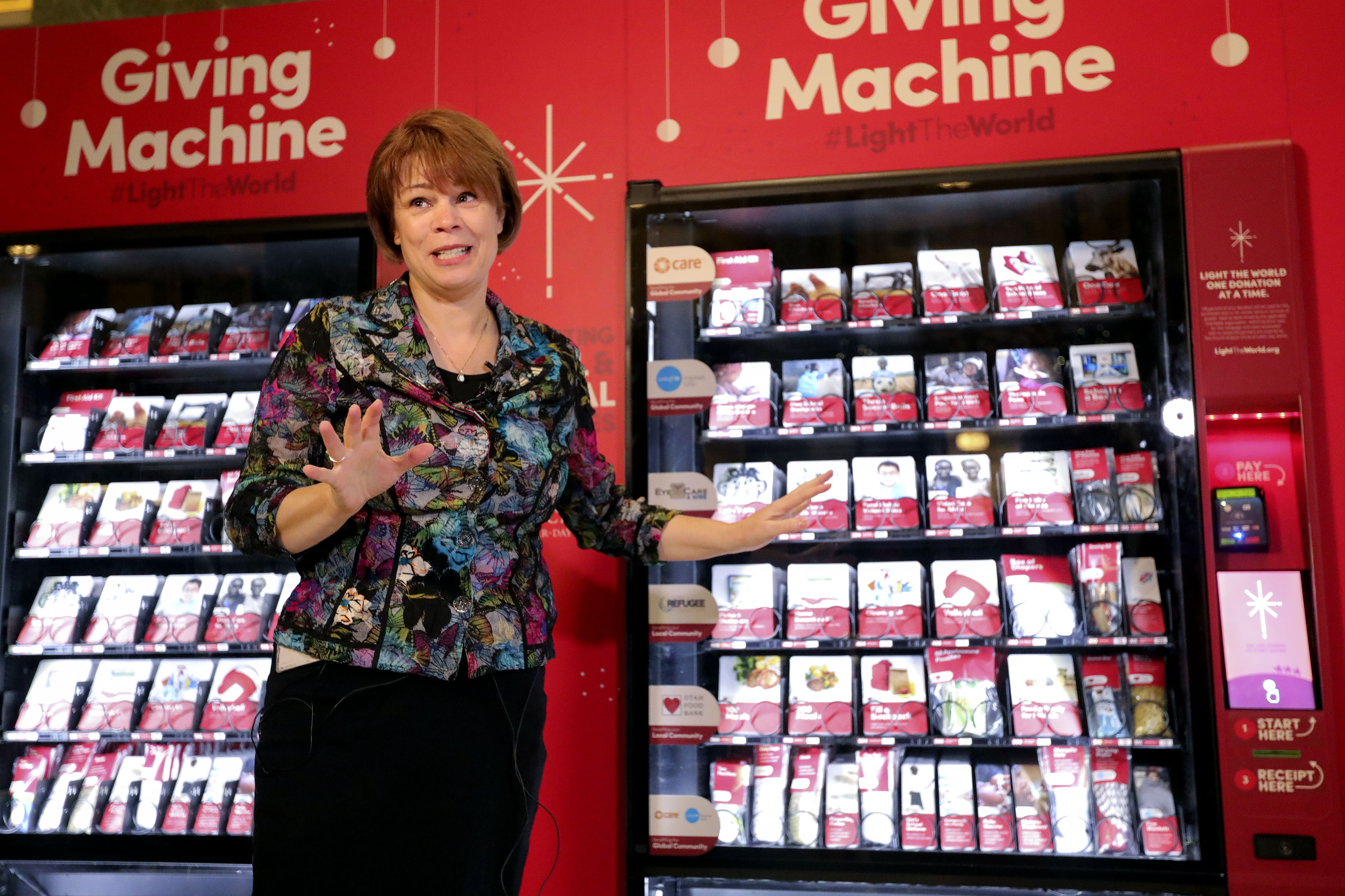 Sharon Eubank, president of LDS Charities and first counselor in the Relief Society general presidency, talks about the Light the World Giving Machine in the lobby of the Joseph Smith Memorial Building in Salt Lake City on Wednesday, Nov. 28, 2018.