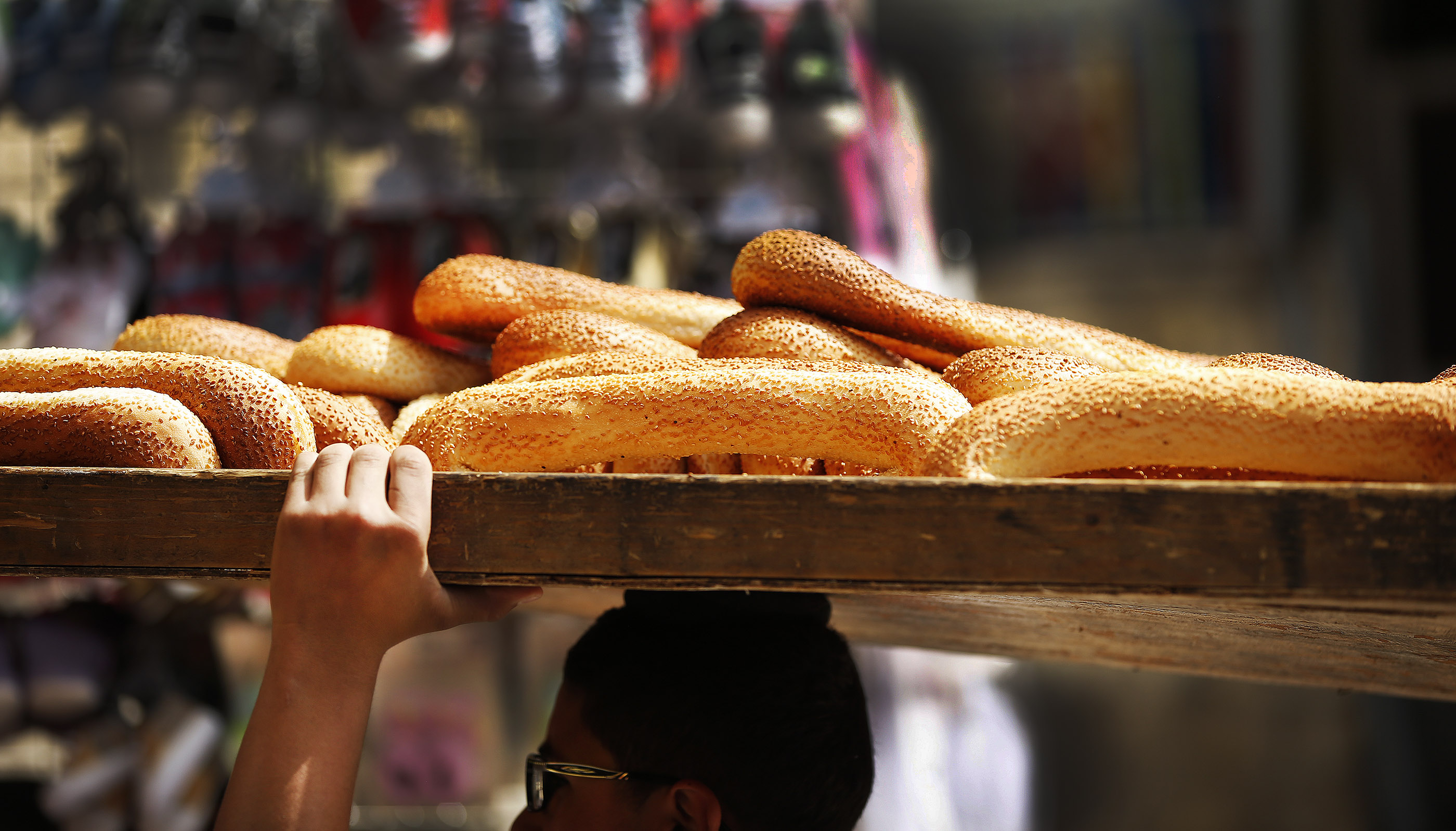 Bread is delivered at the Old City market in Jerusalem on Friday, April 13, 2018.