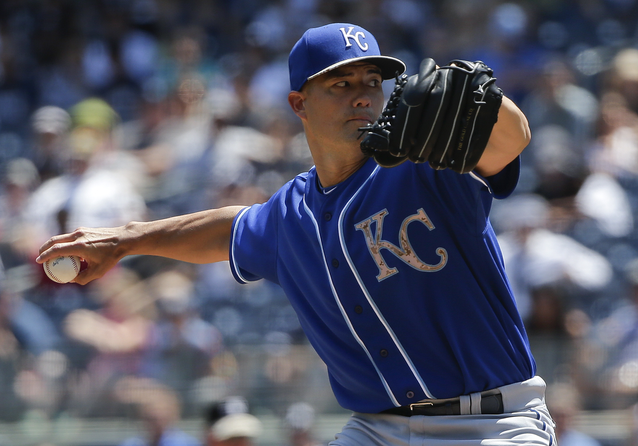 Kansas City Royals pitcher Jeremy Guthrie (11) delivers against the New York Yankees during the first inning of a baseball game, Monday, May 25, 2015, in New York.