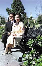 President Jorge Alberto Morales Sanchez and his wife, Blanca, enjoy park near temple.