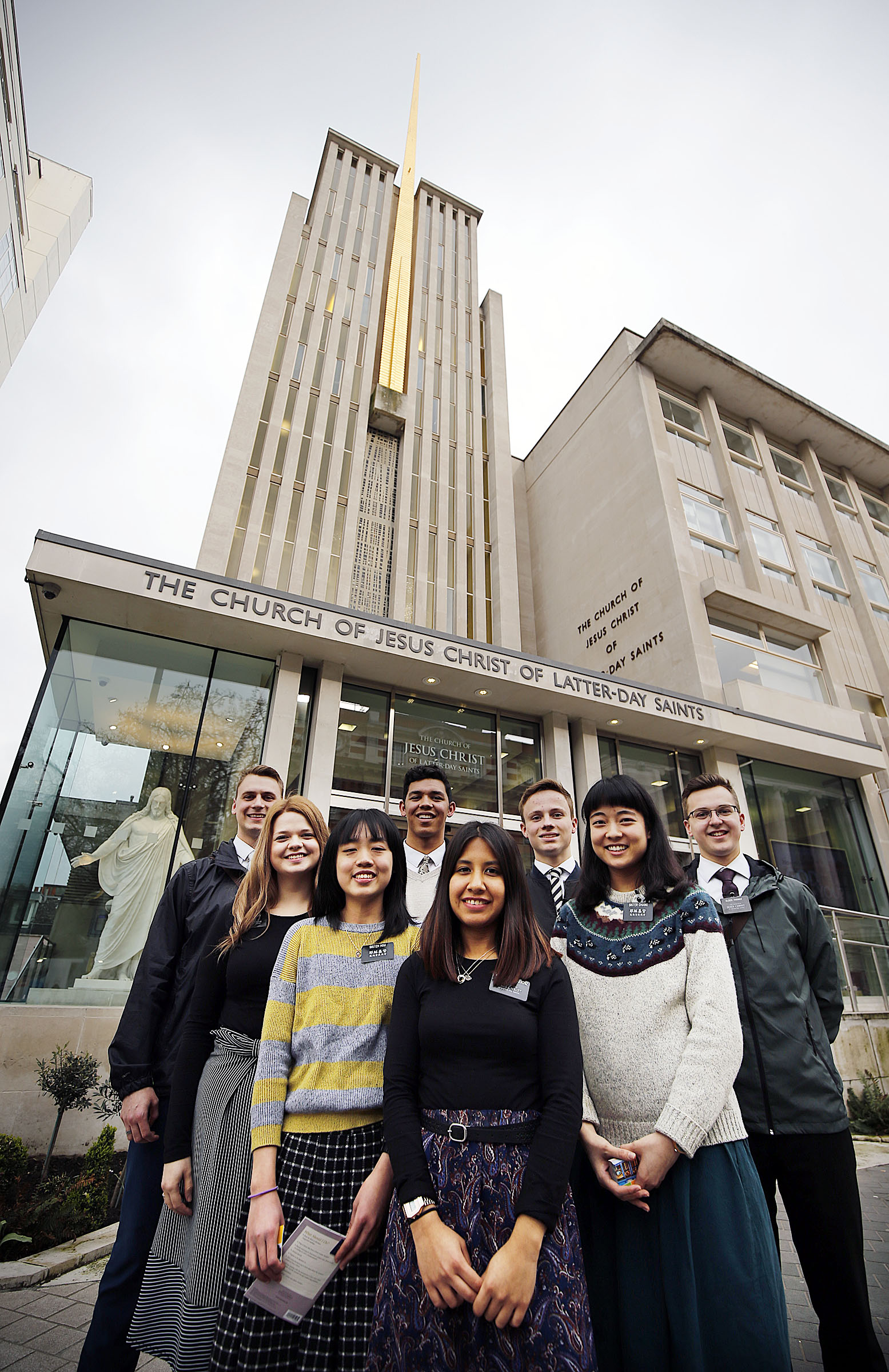 Missionaries pose for a photo in front of the Hyde Park Chapel of The Church of Jesus Christ of Latter-day Saints in London on Tuesday, April 10, 2018.