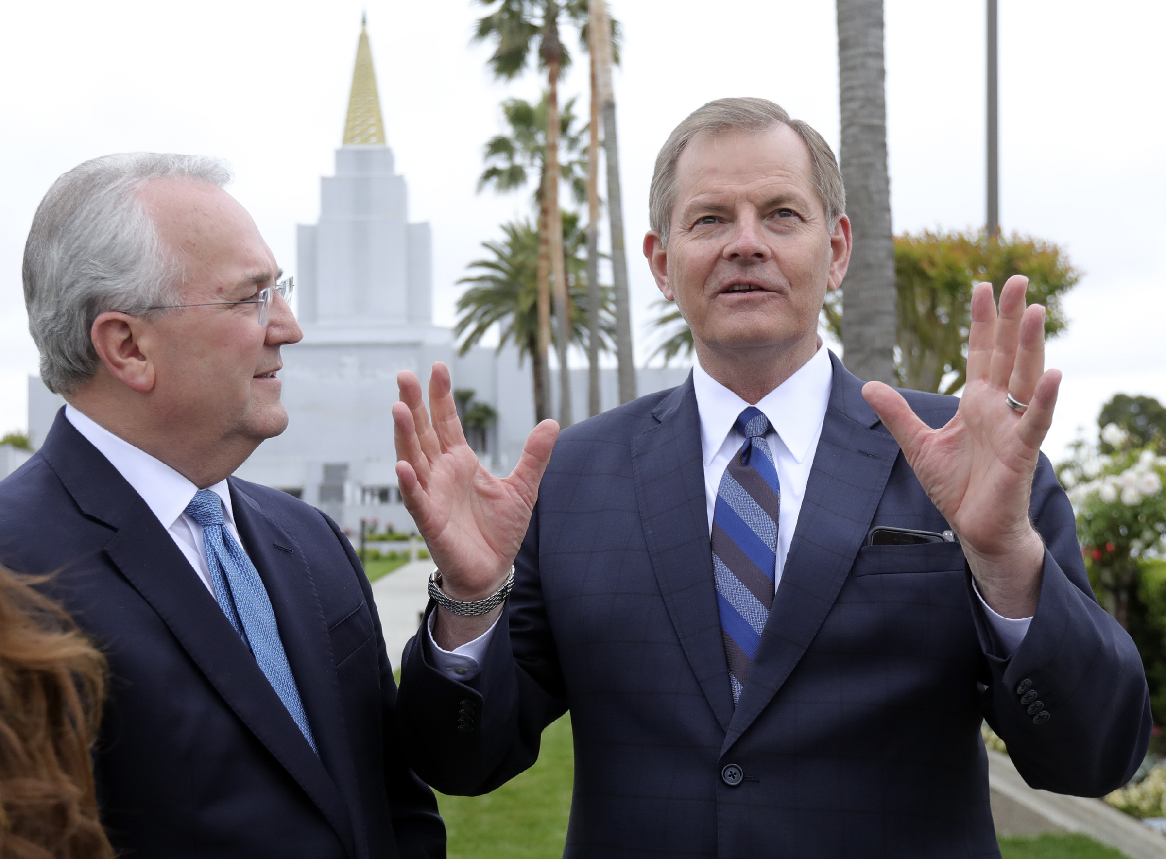 Elder Jack N. Gerard, right, a General Authority Seventy, and Elder Gary E. Stevenson, of the Quorum of the Twelve Apostles talk to members of the media outside of the newly renovated Oakland California Temple, of The Church of Jesus Christ of Latter-day Saints, in Oakland, Calif., on Monday, May 6, 2019.