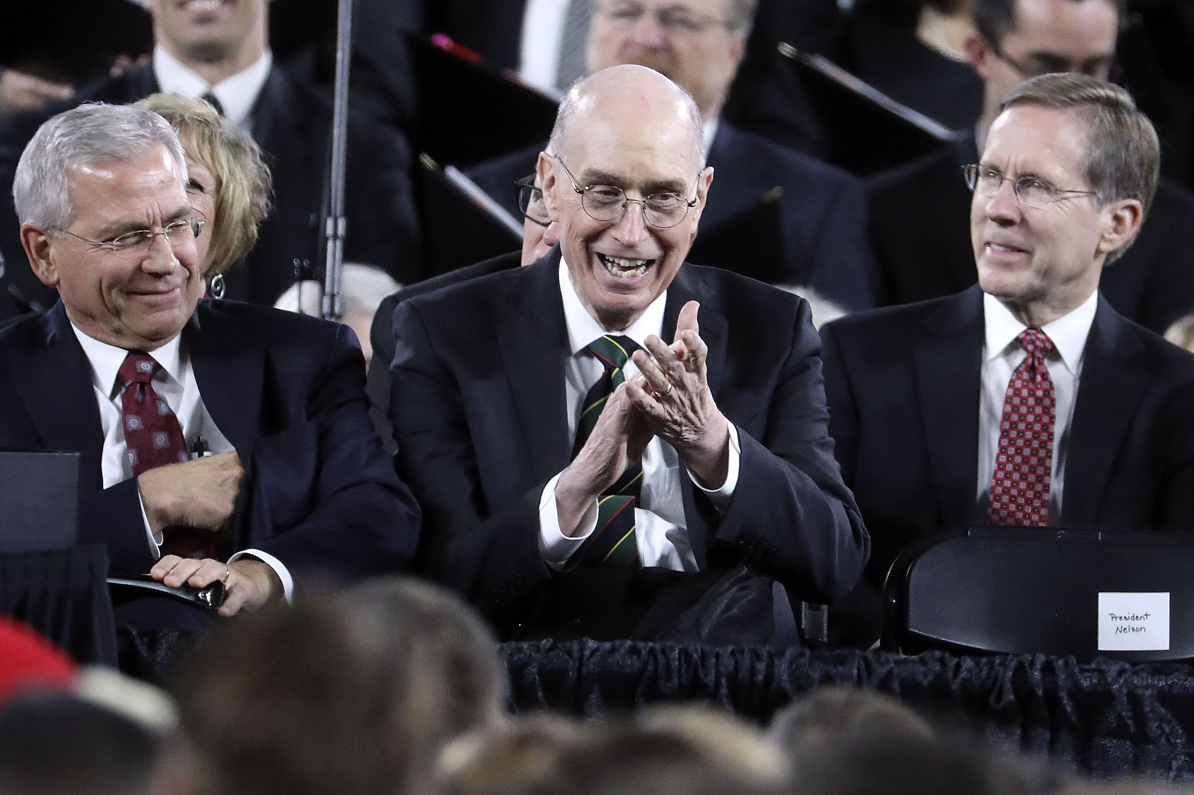 President Henry B. Eyring, second counselor in the First Presidency, laughs as President Russell M. Nelson of The Church of Jesus Christ of Latter-day Saints speaks at Safeco Field in Seattle, Wash., on Saturday, Sept. 15, 2018.