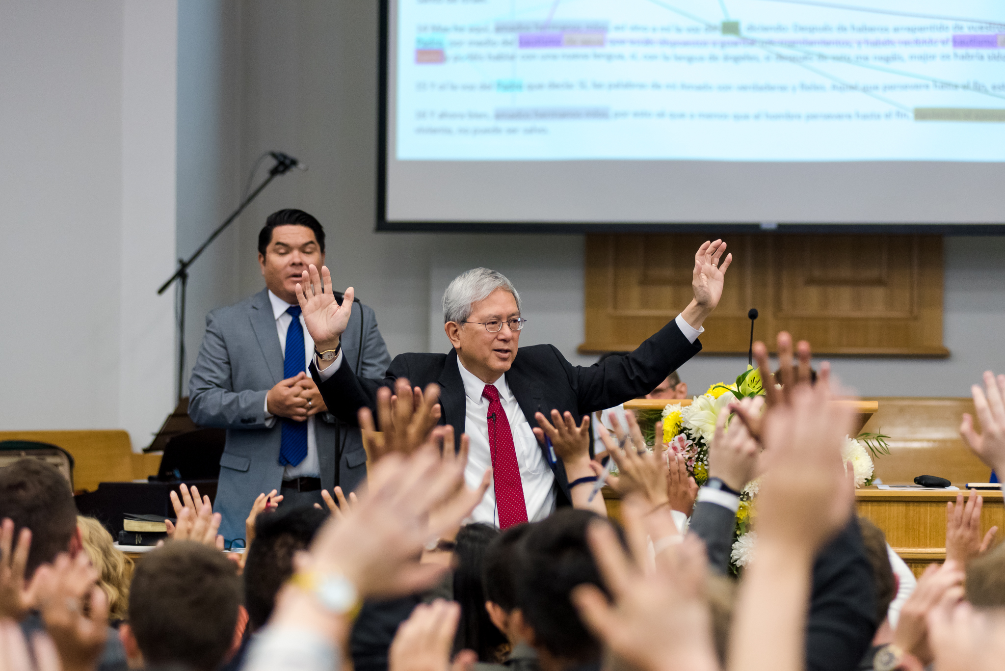 Elder Gong asks missionaries to raise their hands to show love for their mission president and his wife following a conference with missionaries in the Chile Rancagua Mission on Nov. 10.