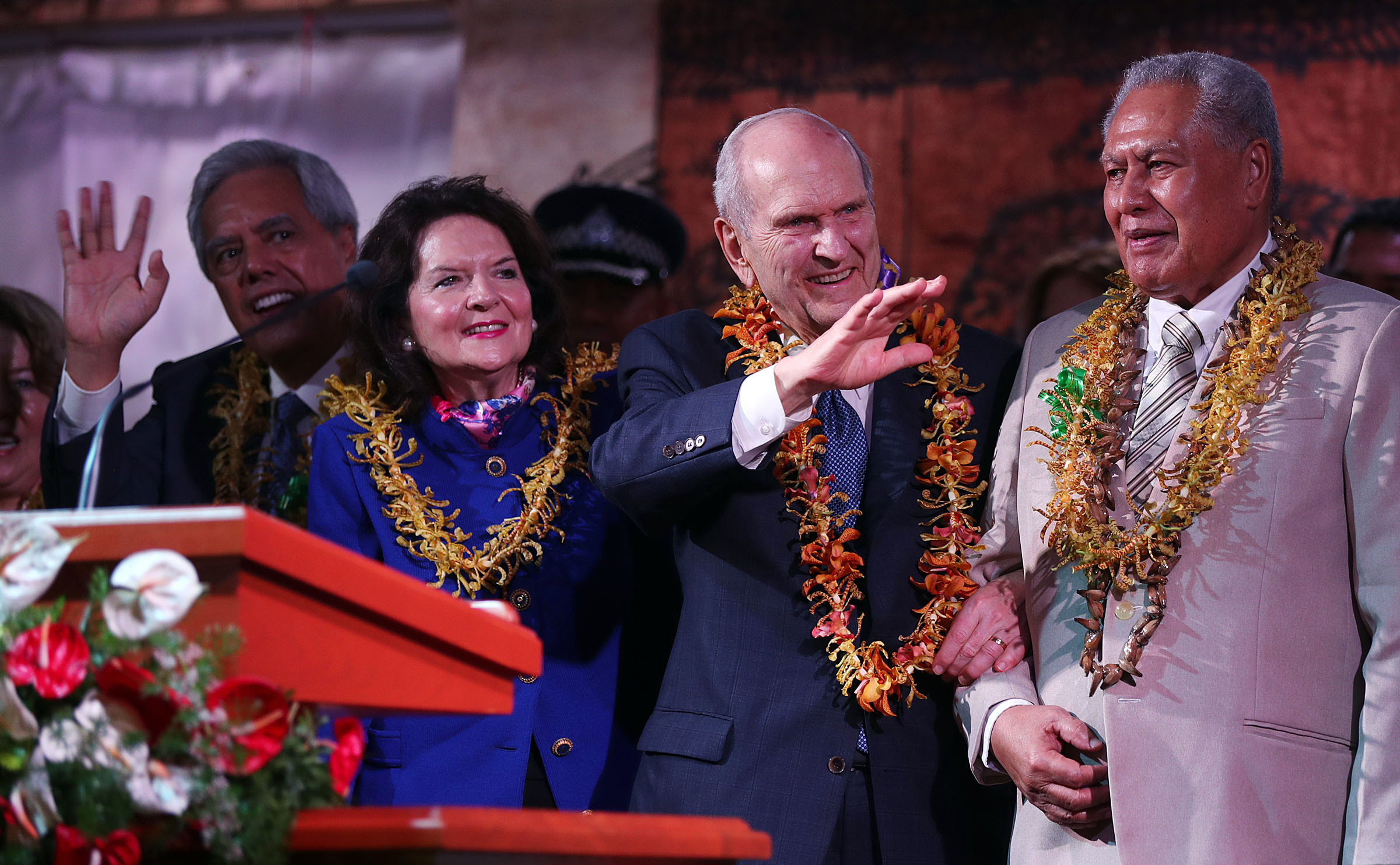 President Russell M. Nelson of The Church of Jesus Christ of Latter-day Saints and his wife, Sister Wendy Nelson, left, wave to those in attendance following a devotional in Apia, Samoa, on Saturday, May 18, 2019. At right is His Highness Tuimaleali'ifano Va'aleto'a Eti Sualauvi II, Samoa Head of State.
