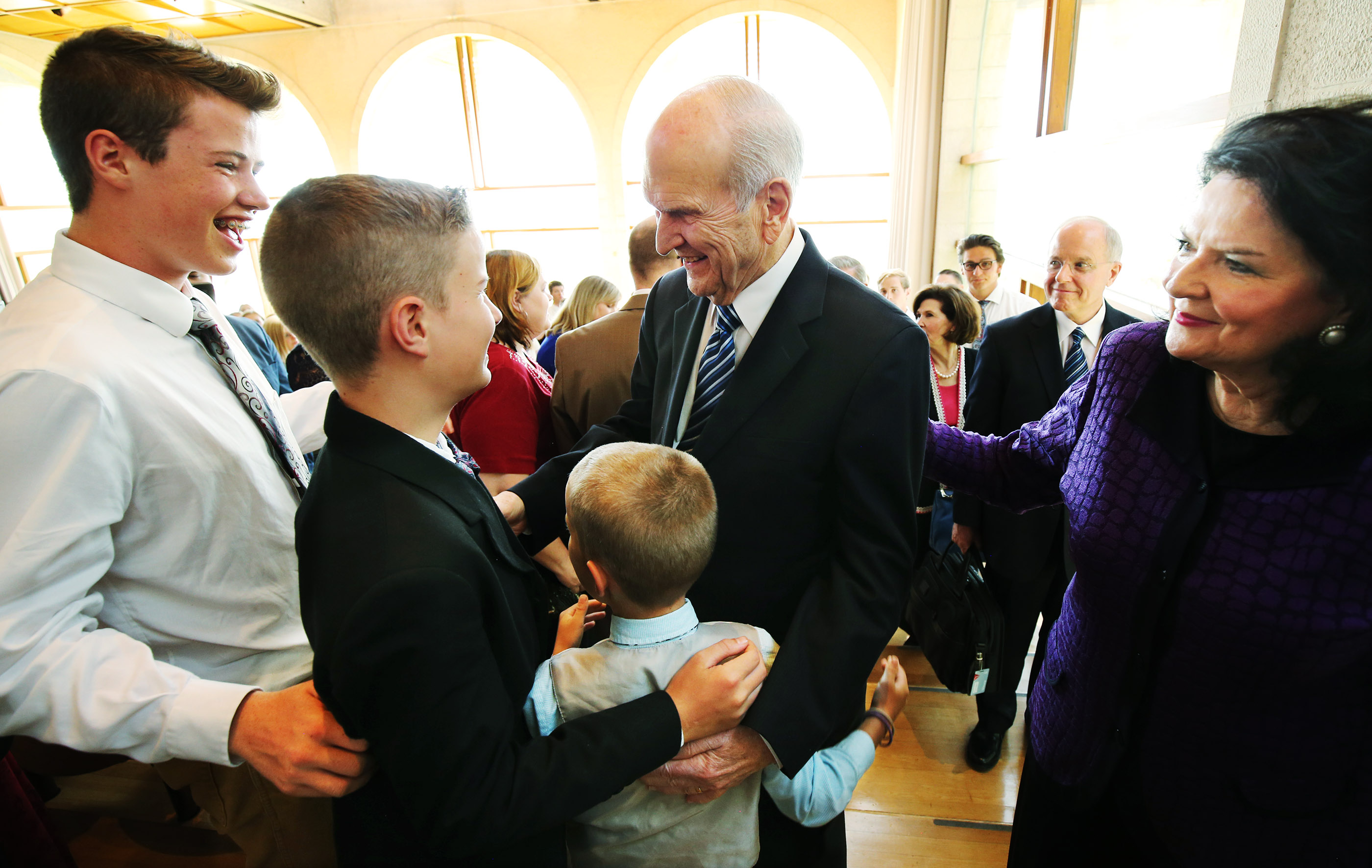 President Russell M. Nelson, president of The Church of Jesus Christ of Latter-day Saints, and his wife, Sister Wendy Nelson, talk with brothers James , Paul and and Adam Howell after speaking during Jerusalem District Conference at the BYU Jerusalem Center in Jerusalem on Saturday, April 14, 2018.