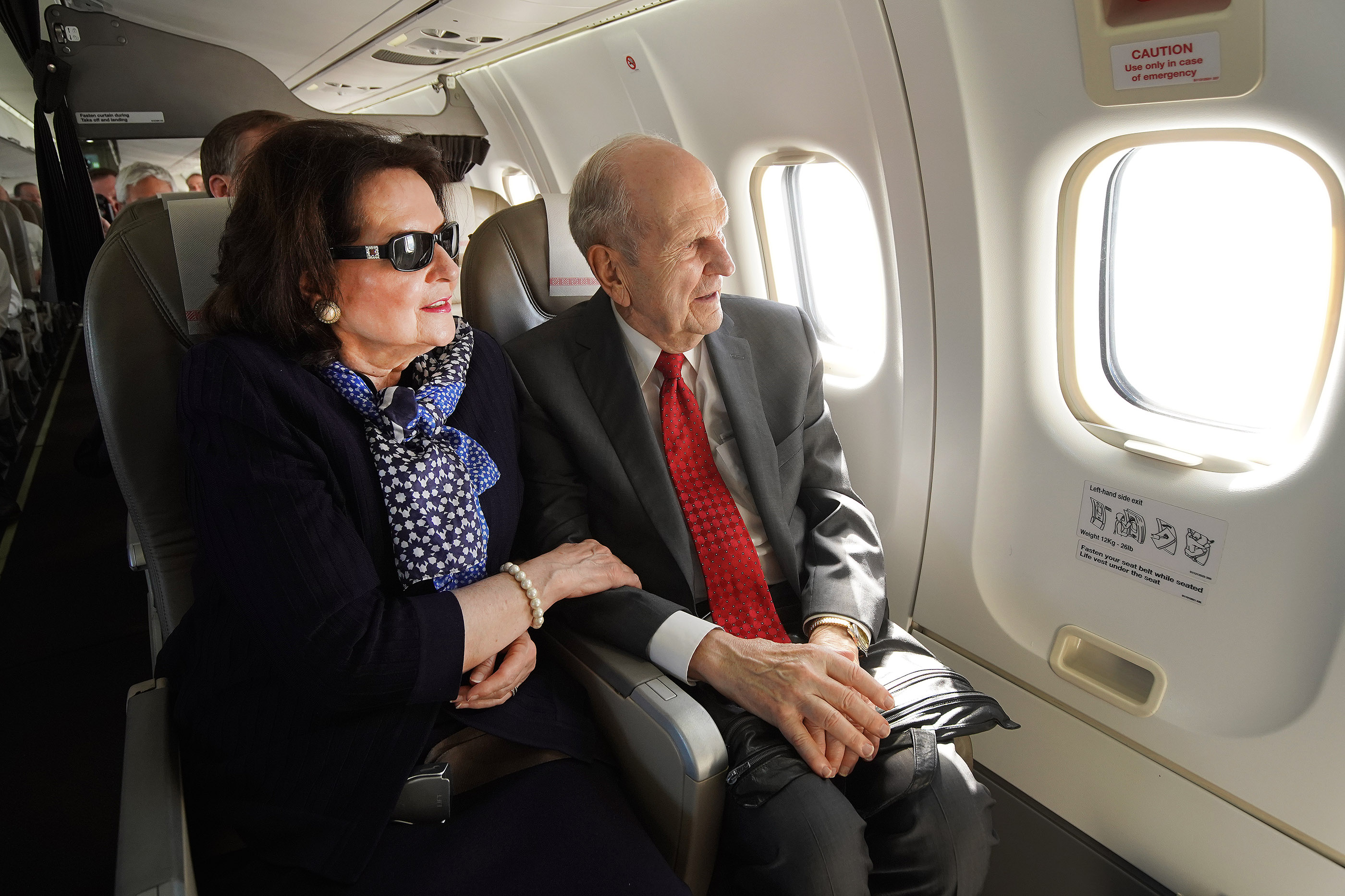 President Russell M. Nelson of The Church of Jesus Christ of Latter-day Saints and his wife, Sister Wendy Nelson, look out of the window while flying to a devotional in Nausori, Fiji on May 22, 2019.