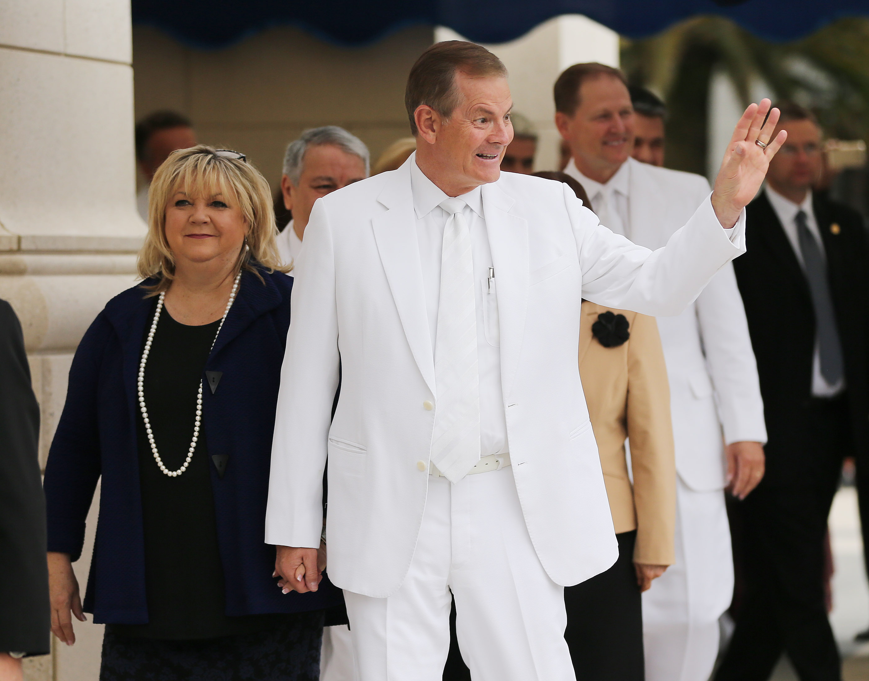 Elder Gary E. Stevenson of The Church of Jesus Christ of Latter-day Saints' Quorum of the Twelve Apostles — joined by his wife, Sister Lesa Stevenson — waves while outside the Concepción Chile Temple for the cornerstone ceremony. The temple was dedicated Sunday, Oct. 28, 2018, in Concepcion, Chile.