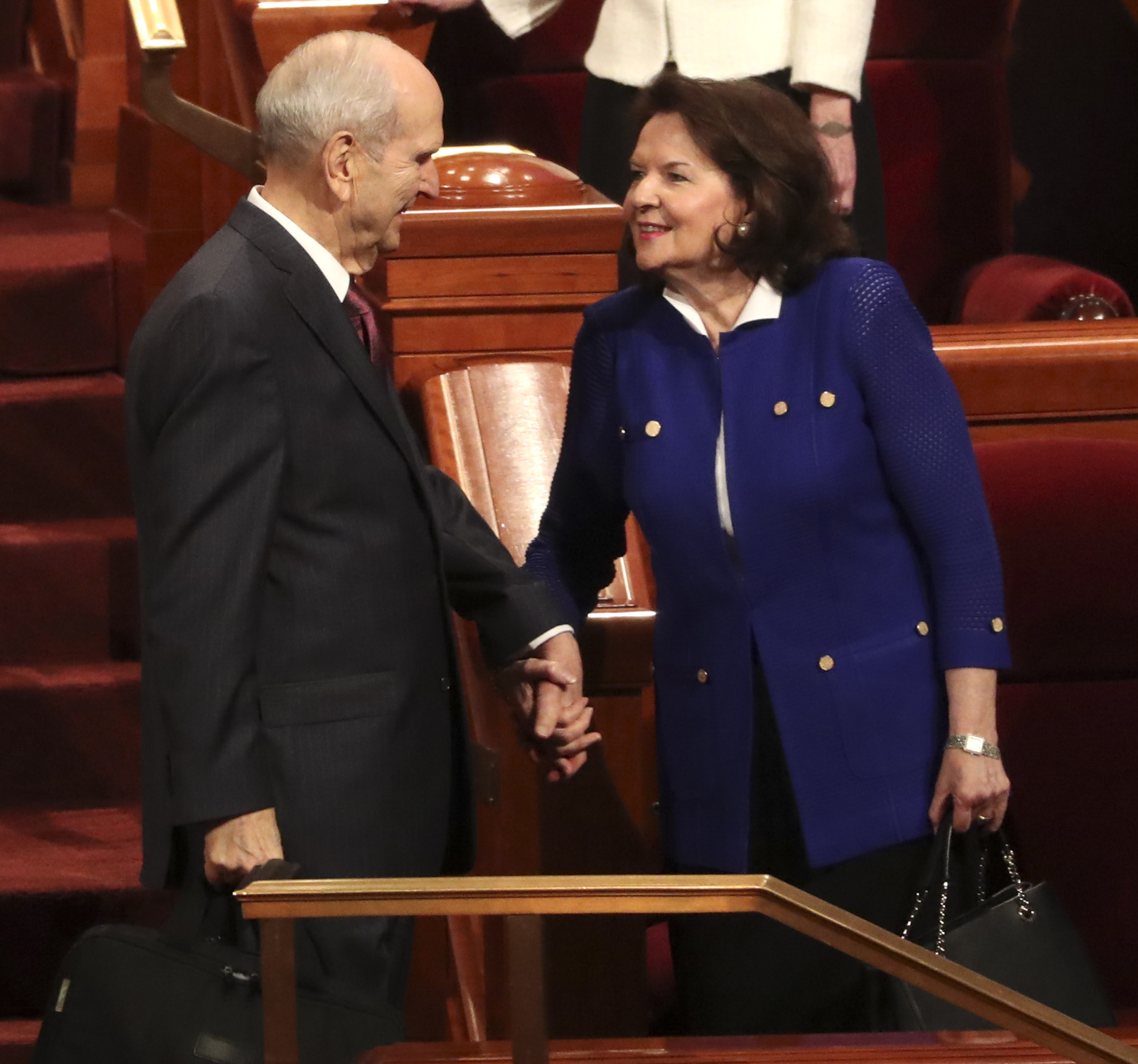 President Russell M. Nelson is greeted by his wife, Sister Wendy Watson Nelson, as they prepare to leave the Conference Center following the morning session of general conference in Salt Lake City on Sunday, April 7, 2019.