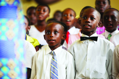 Primary children in Accra, Ghana, sing during a member meeting presided over by Elder Jeffrey R. Holland of the Quorum of the Twelve. Elder Holland and other leaders traveled to Ghana, Liberia and Sierra Leone Feb. 11-19. Elder Holland said he sees a bright future for Latter-day Saints in Africa, especially the children.