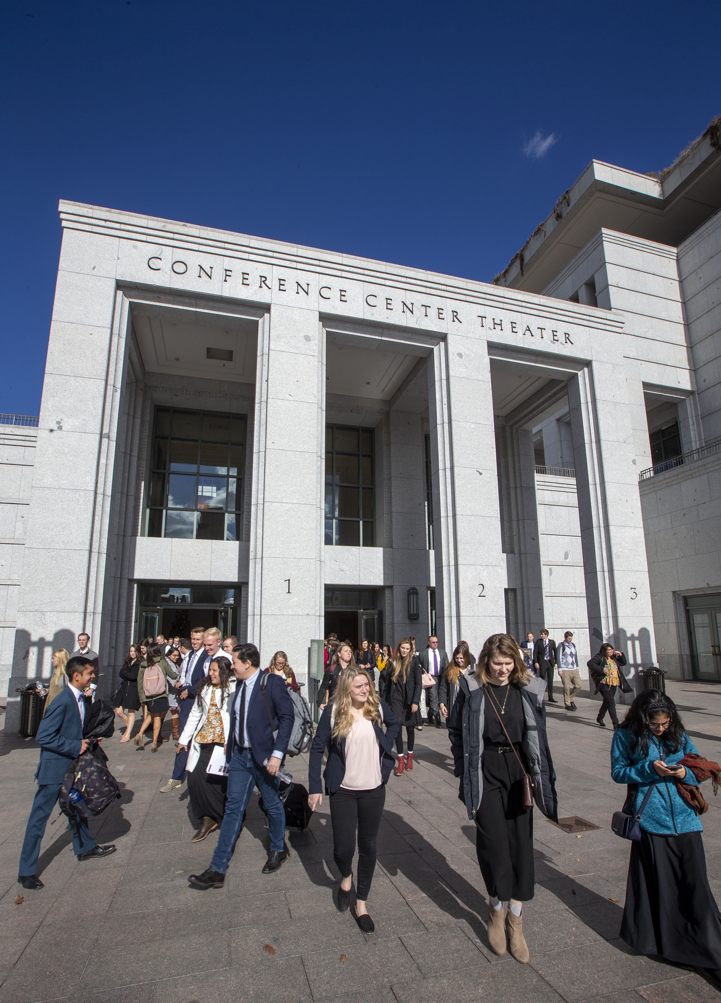 Audience members exit the Conference Center Theater after listening to President Henry B. Eyring of the First Presidency speak to LDS Business College students following a devotional on Tuesday, Nov. 6, 2018.
