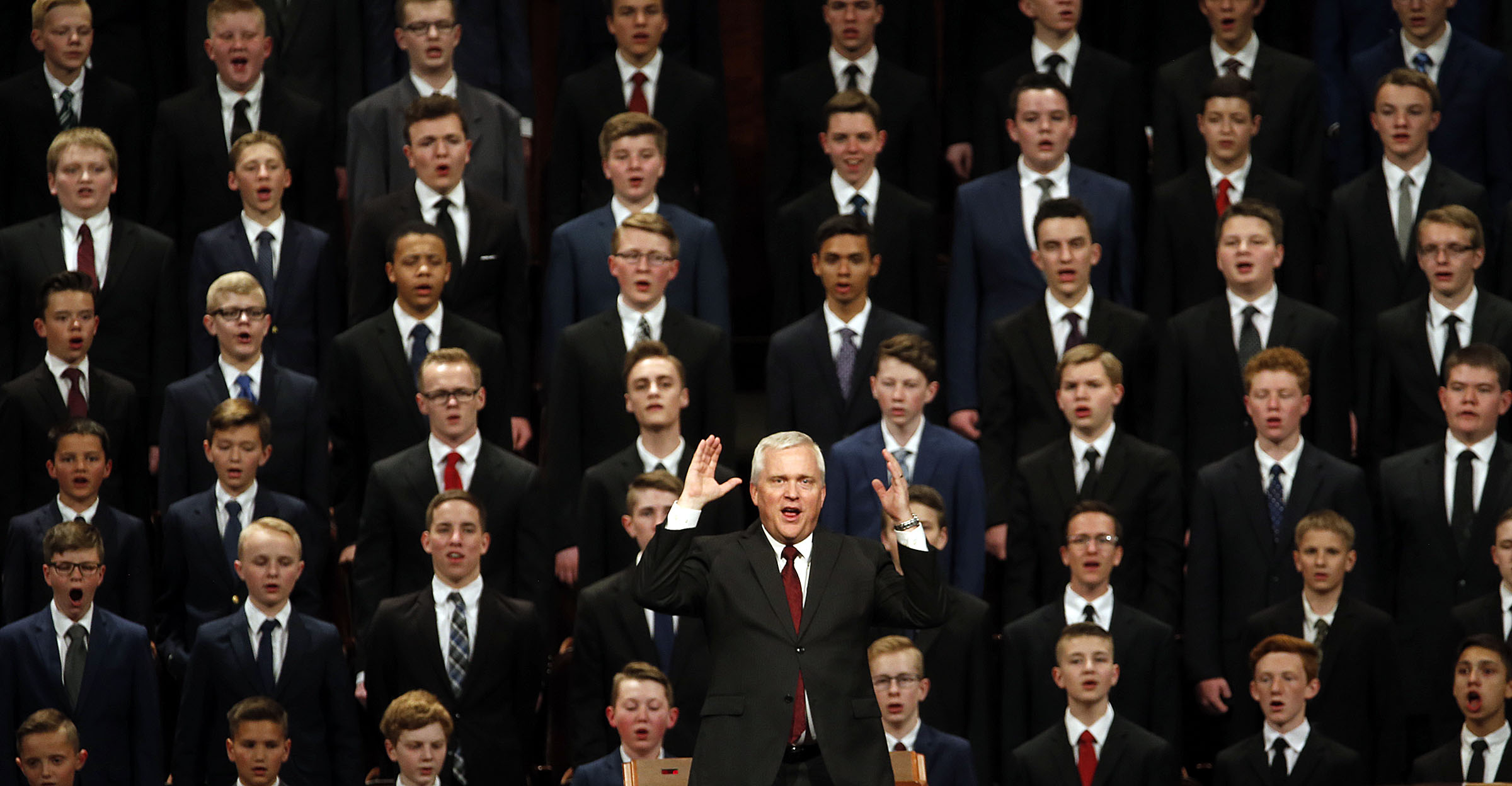 An Aaronic Priesthood choir from stakes in Layton, Utah, joins with the congregation in singing during the priesthood session of the 189th Annual General Conference of The Church of Jesus Christ of Latter-day Saints in the Conference Center in Salt Lake City on Saturday, April 6, 2019.