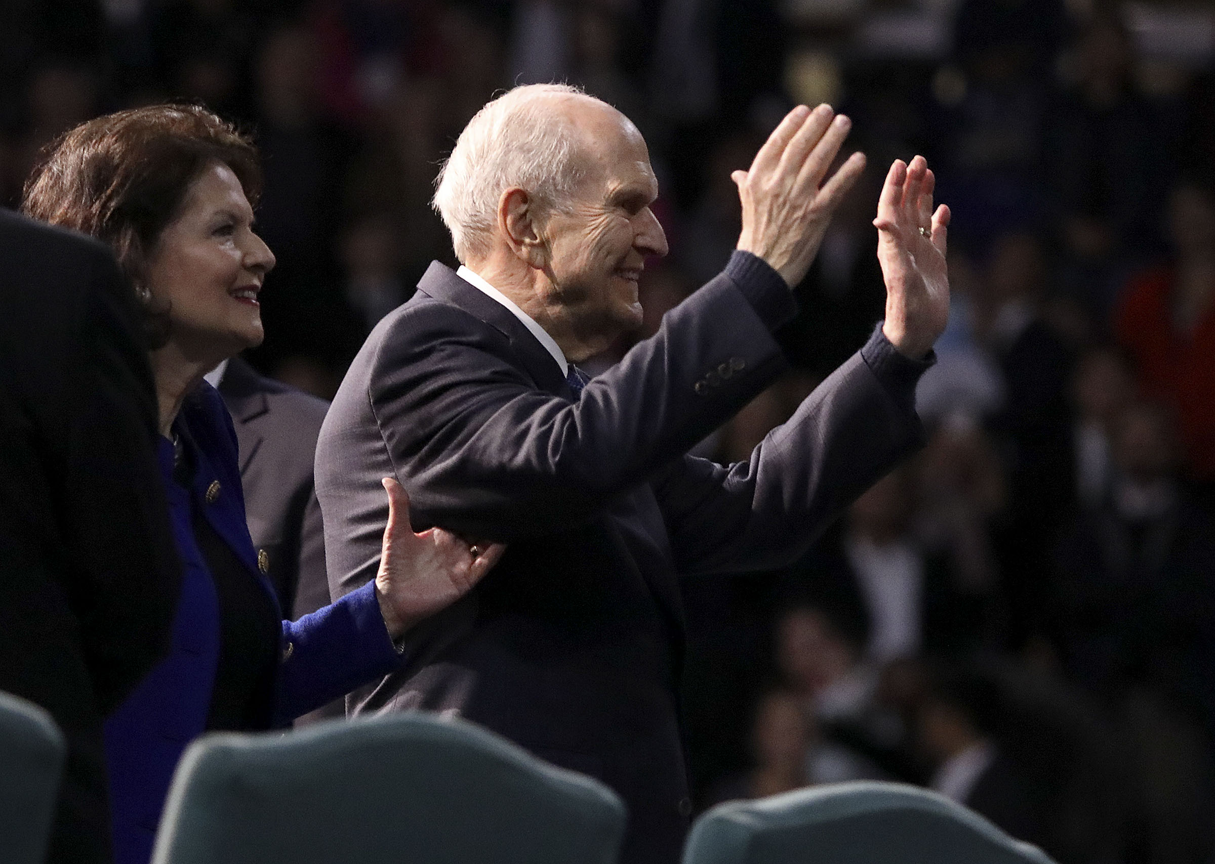 President Russell M. Nelson of The Church of Jesus Christ of Latter-day Saints waves to the choir after speaking at the Langley Events Center in Langley, British Columbia, on Sunday, Sept. 16, 2018.