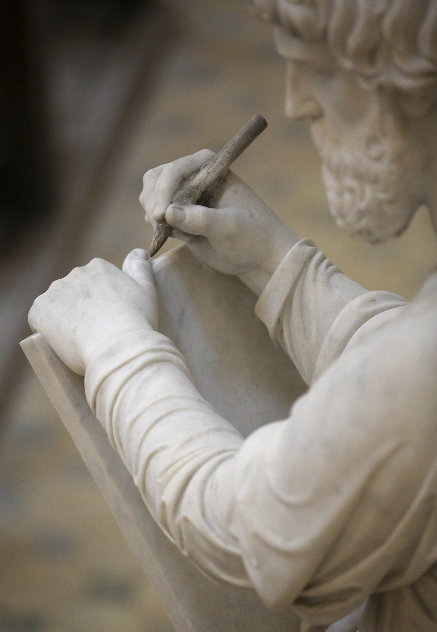 Bertel Thorvaldsen's statue of Matthew, one of the 12 apostles, holds a tablet at the Church of Our Lady in Copenhagen, Denmark, on Tuesday, Nov. 13, 2018. The 12 apostles statues were carved out of Carrara marble between 1829 and 1848. Replicas of the statues are now on display in the Rome Temple Visitors' Center in Italy.