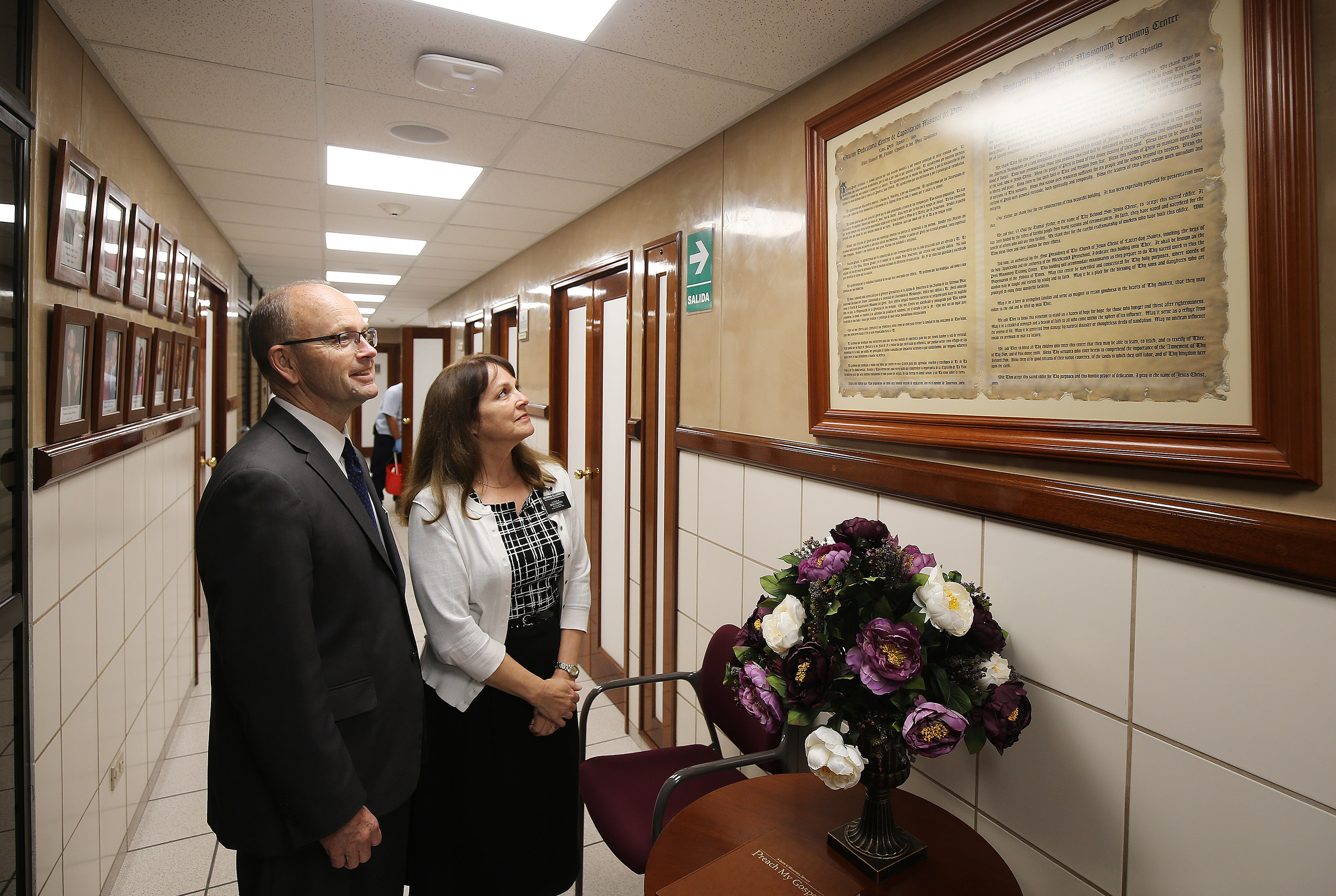 President R. Spence Ellsworth of the Peru Missionary Training Center and his wife, Sister Laurie Ellsworth, look over the dedicatory prayer by President Russell Nelson displayed at the training center in Lima, Peru on Friday, Oct. 19, 2018.