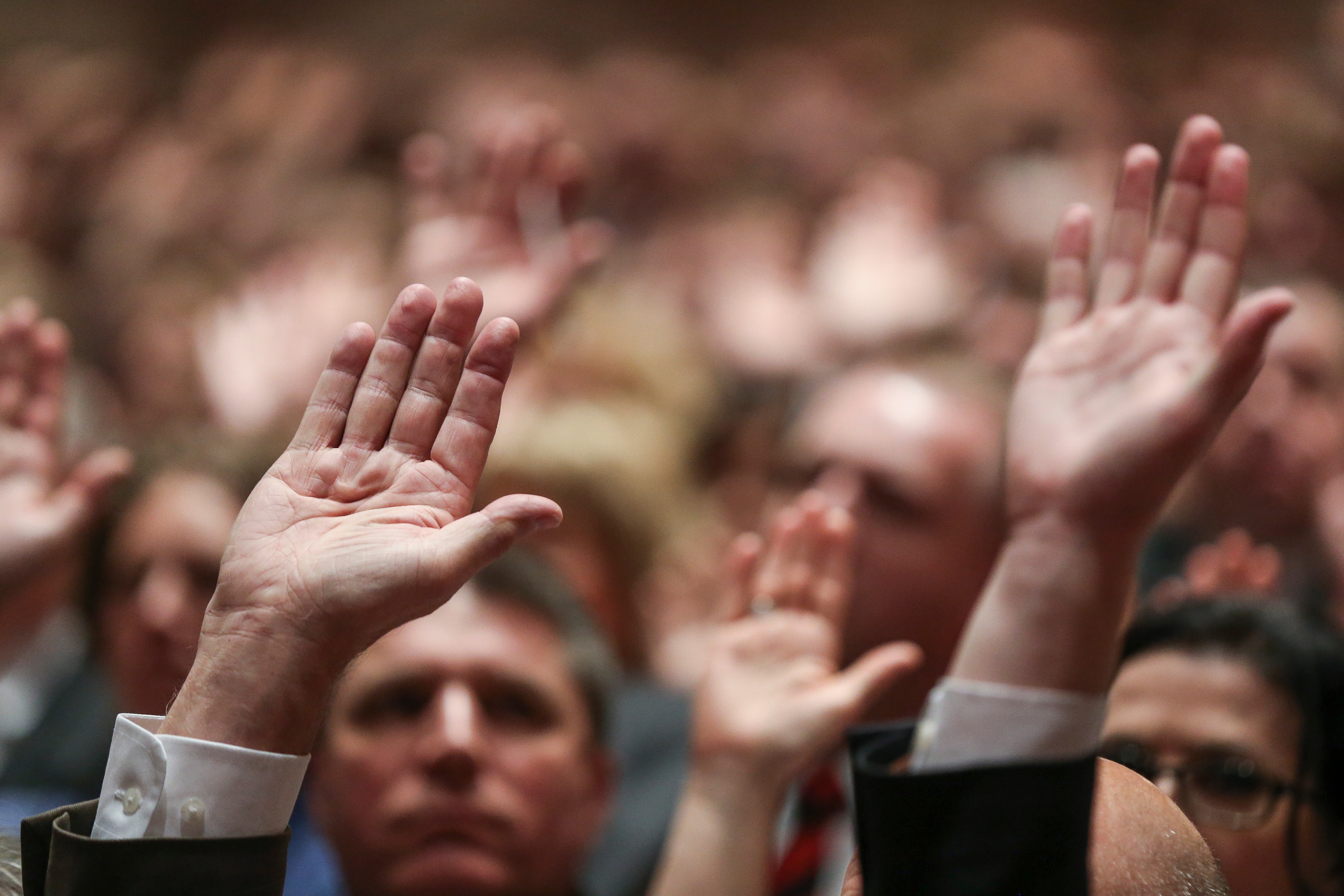 Conferencegoers raise their hands to sustain church leadership during the Saturday afternoon session of the 188th Annual General Conference of the Church at the Conference Center in Salt Lake City on March 31, 2018.