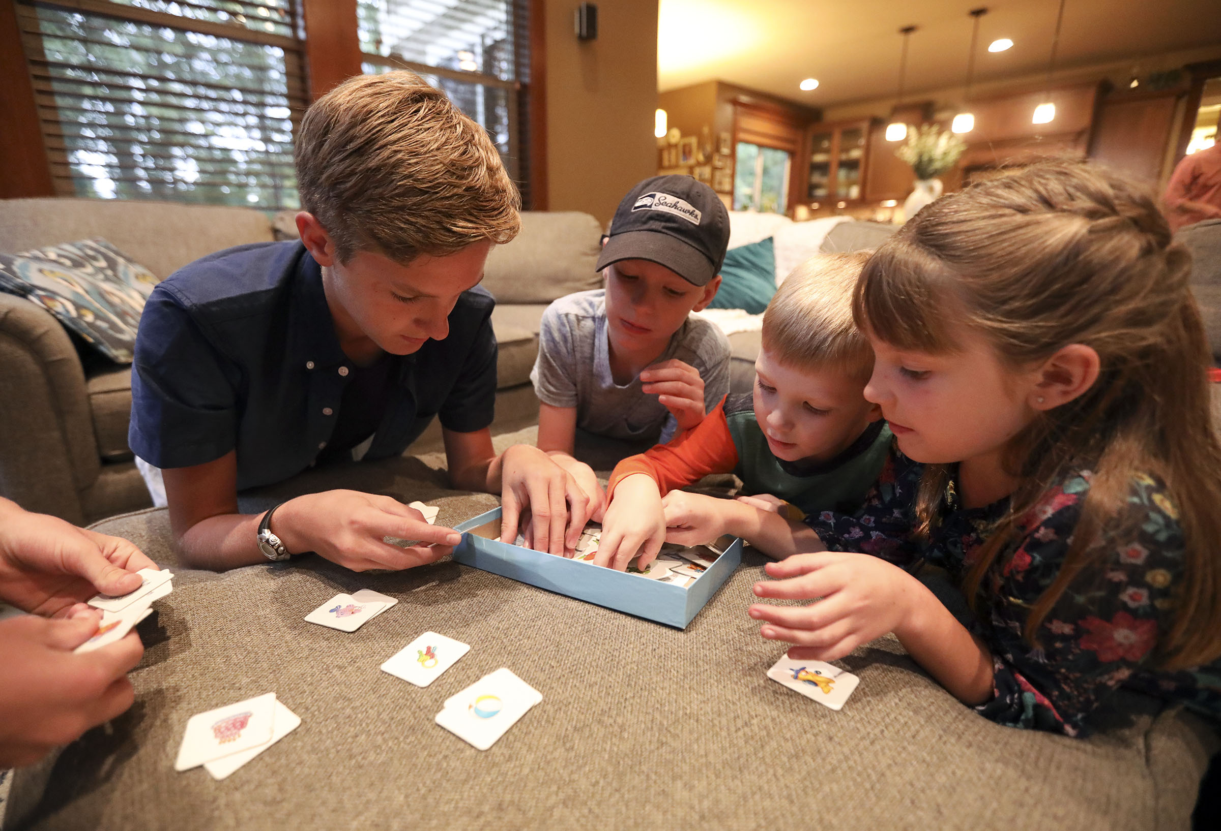 Ben, Tom, Daniel and Emilia Allen play Memory at home in Renton, Wash., on Friday, Sept. 14, 2018.