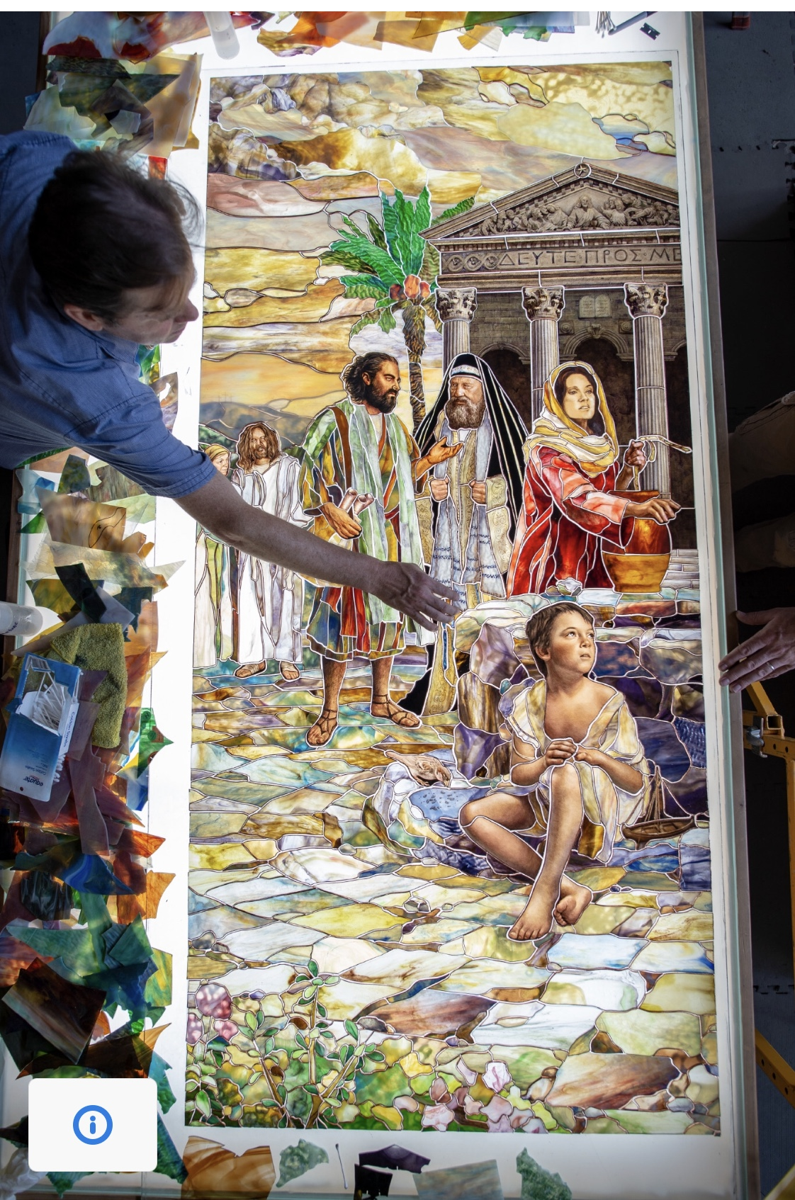 """An overhead view of Tom Holdman adjusting pieces for them """"Come Unto Me"""" art glass installation created for the Rome Italy Temple visitors' center."""