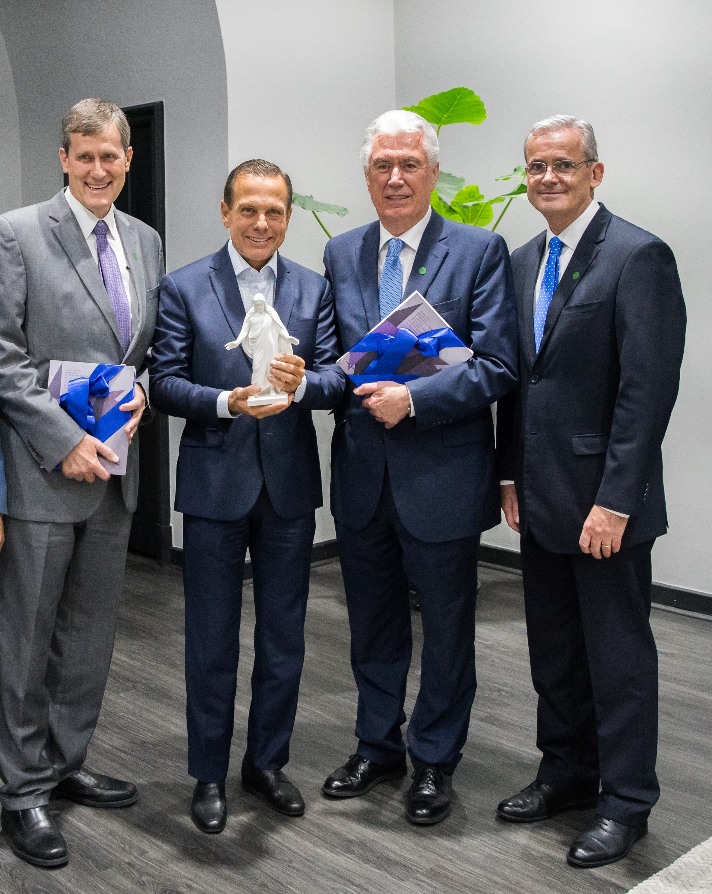 João Doria, second from left, the governor of the Brazilian state of Sao Paulo, is joined by, Elder Dieter F. Uchtdorf of the Quorum of the Twelve Apostles, second from right; Elder Patrick Kearon of the Presidency of the Seventy, right; and Elder Marcos A. Aidukaitis, left, a General Authority Seventy and president of the Brazil Area. They met Feb. 19, 2019, at the Palacio dos Bandeirantes in Sao Paulo, Brazil.
