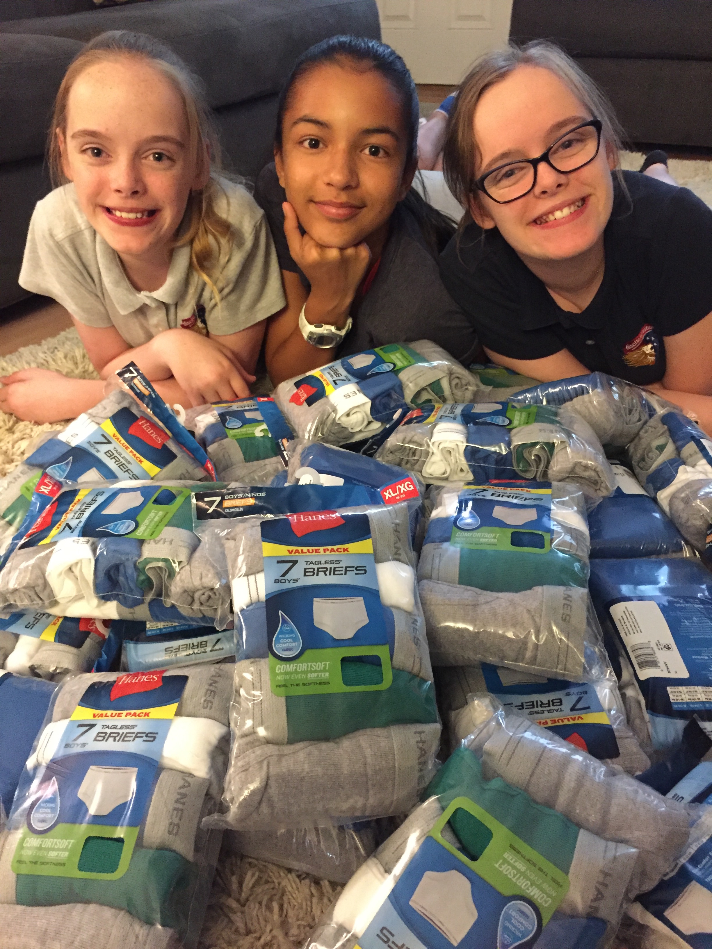 Mirabel Atkinson,left, Isabel Marchena, center, and Sofia Atkinson, right, posing with a few of the more than 7,000 pairs of underwear they collected and donated to the Children's National Medical Center.