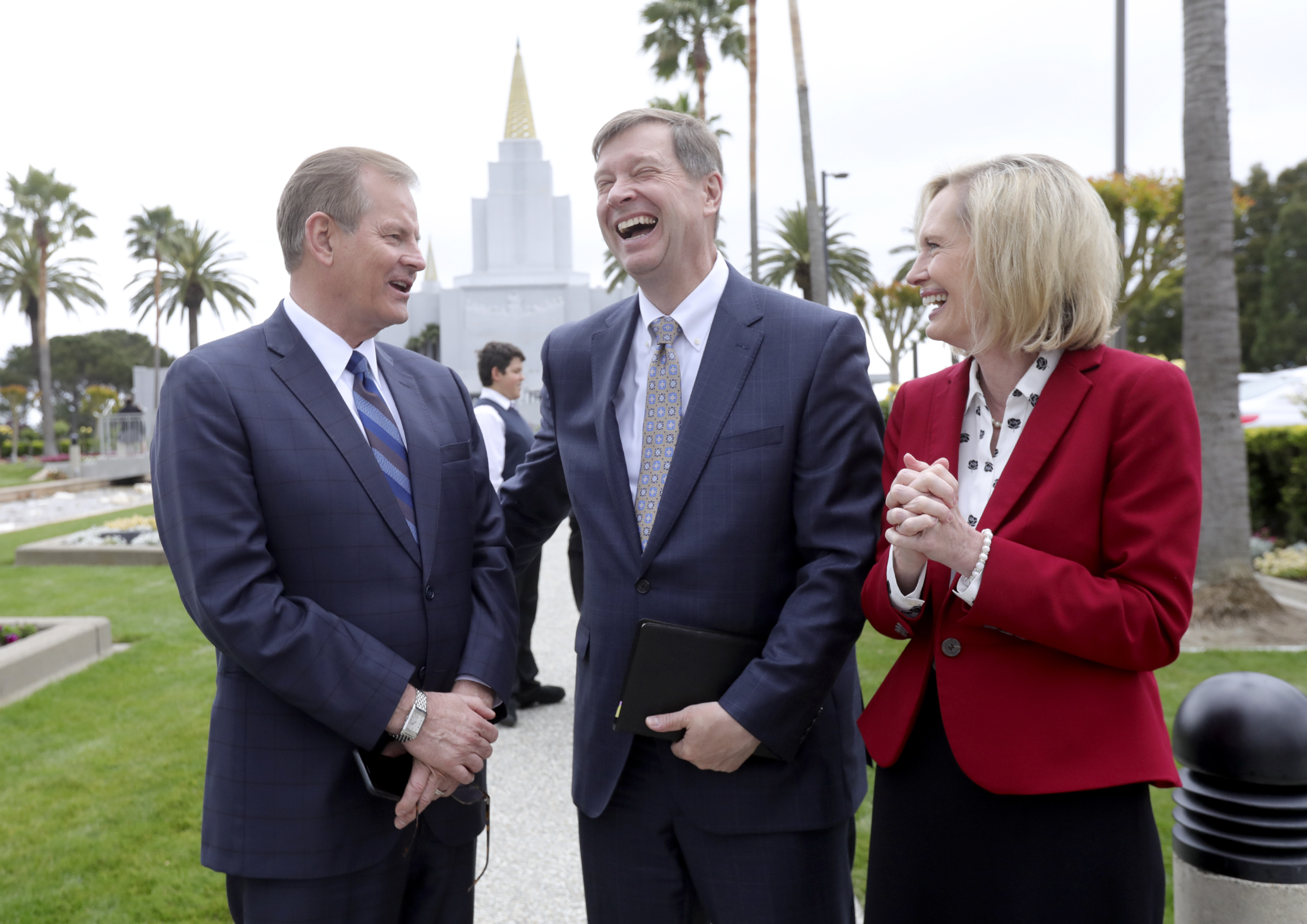 Elder Gary E. Stevenson, left, of the Quorum of the Twelve Apostles, Derek Cordon, and Sister Bonnie H. Cordon, Young Women general president, chat outside of the newly renovated Oakland California Temple, of The Church of Jesus Christ of Latter-day Saints, in Oakland, Calif., on Monday, May 6, 2019.