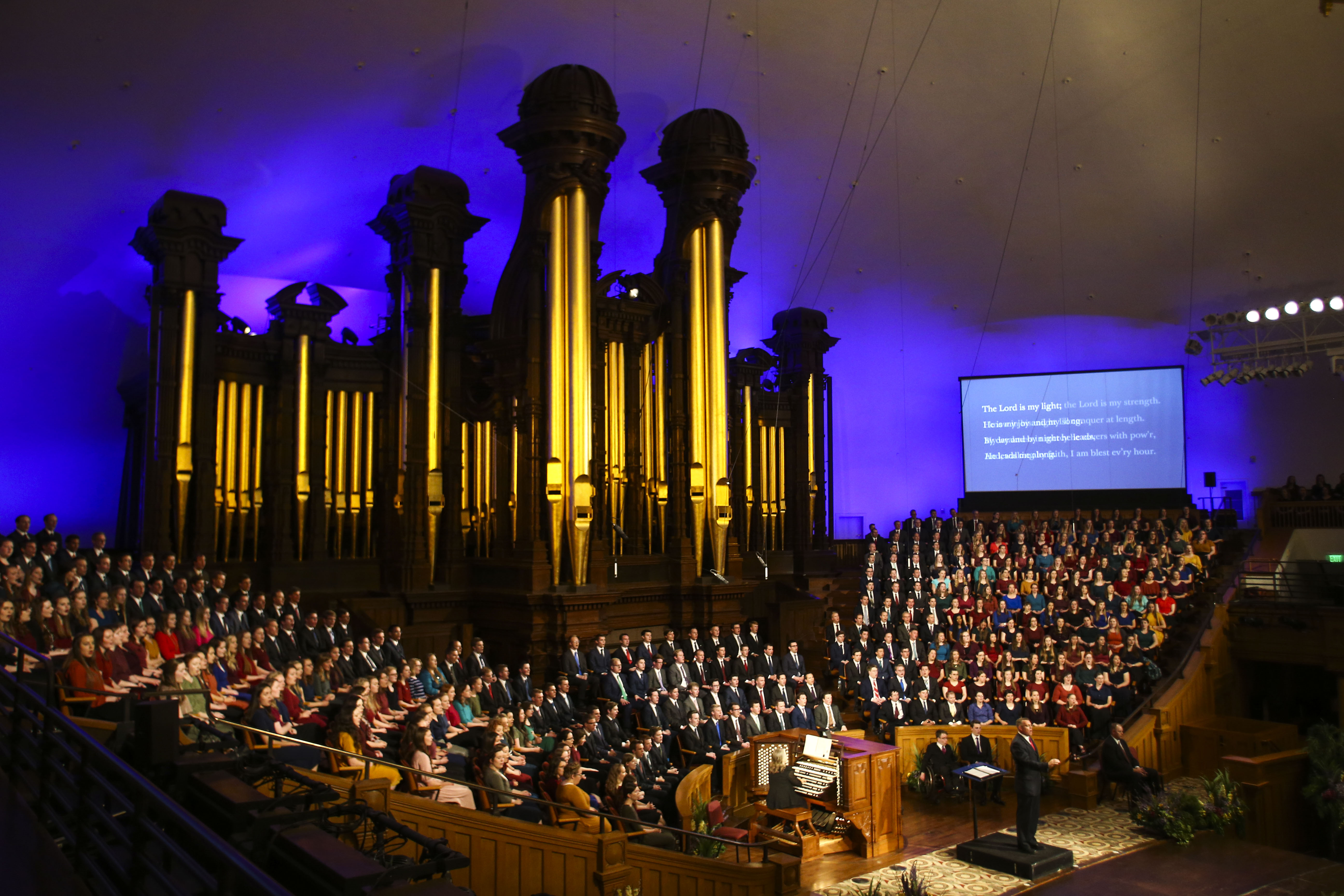 The congregation sings with the choir during the Worldwide Devotional for Young Adults at the Salt Lake Tabernacle in Salt Lake City on Sunday, May 5, 2019.
