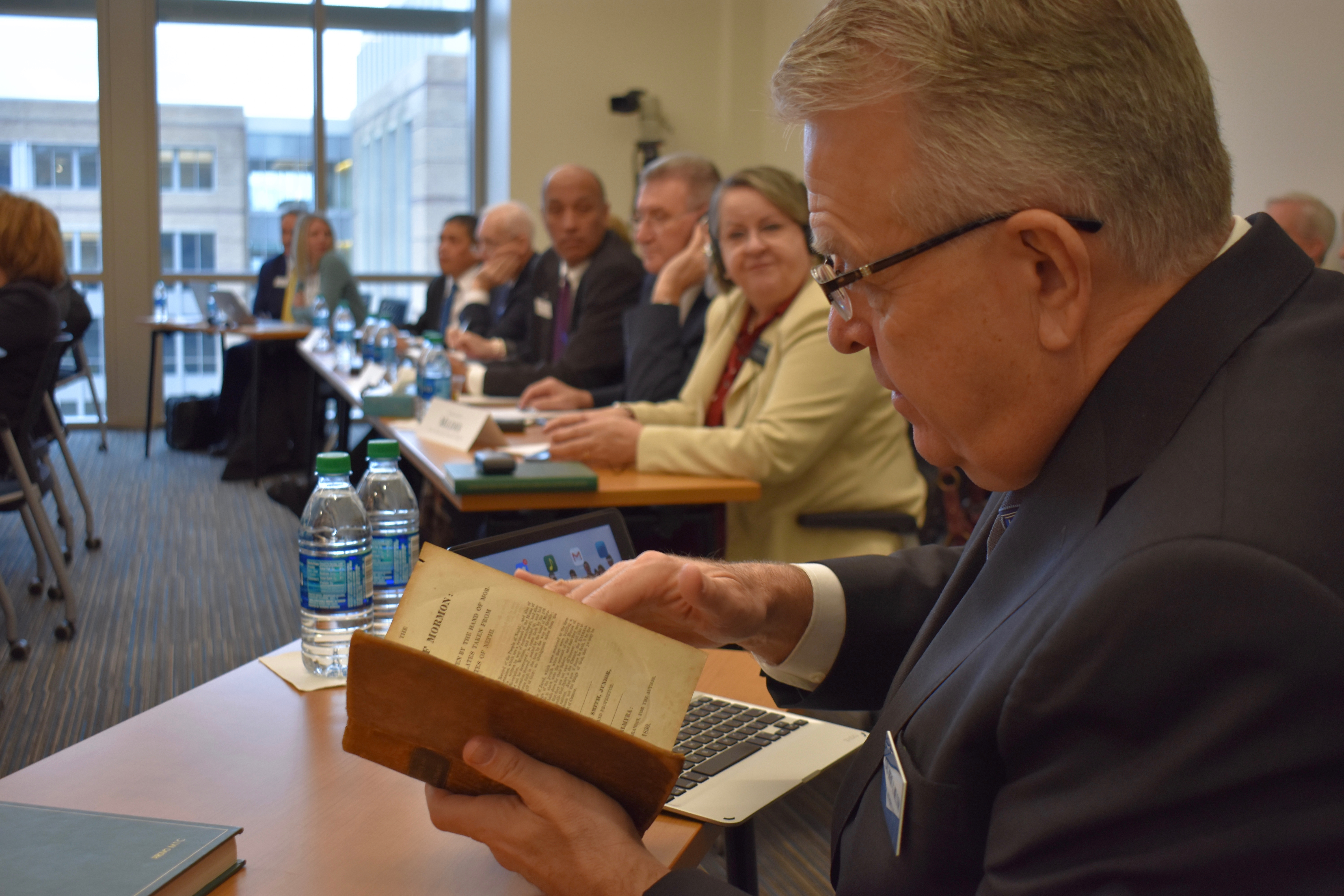 Elder Brent H. Nielson, a General Authority Seventy and executive director of the Missionary Department, thumbs through a first-edition copy of the Book of Mormon on Jan. 16, 2019 during the 2019 MTC Leadership Seminar at the Provo Missionary Training Center.