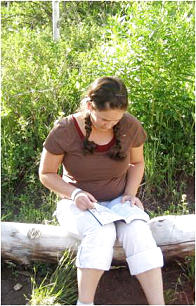A young woman from the American Fork 37th Ward, American Fork Utah East Stake, studies her scriptures at camp. Sister Elaine S. Dalton said camp is a time when everything a young woman has been taught in her home and on Sunday can come into focus.